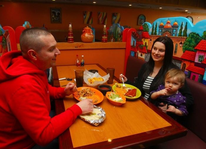Mark and Carol Reele of Lewiston and their daughter, Shaylee, enjoy Mexican food at La Galera in Niagara Falls. (John Hickey/Buffalo News)