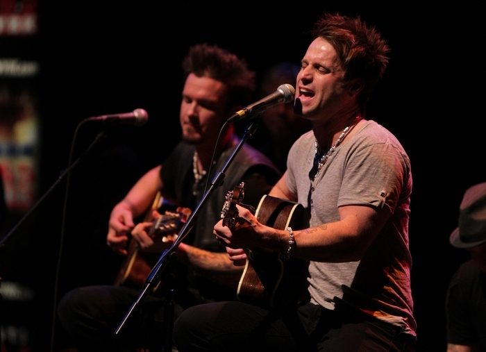 The UB Center for the Arts hosted WYRK Energy Mark Accoustic Concert, Thursday, March 13, 2014. Craig Morgan, Cassadee Pope and Parmalee performed. Parmalee and his band sing a song. (Sharon Cantillon/Buffalo News)