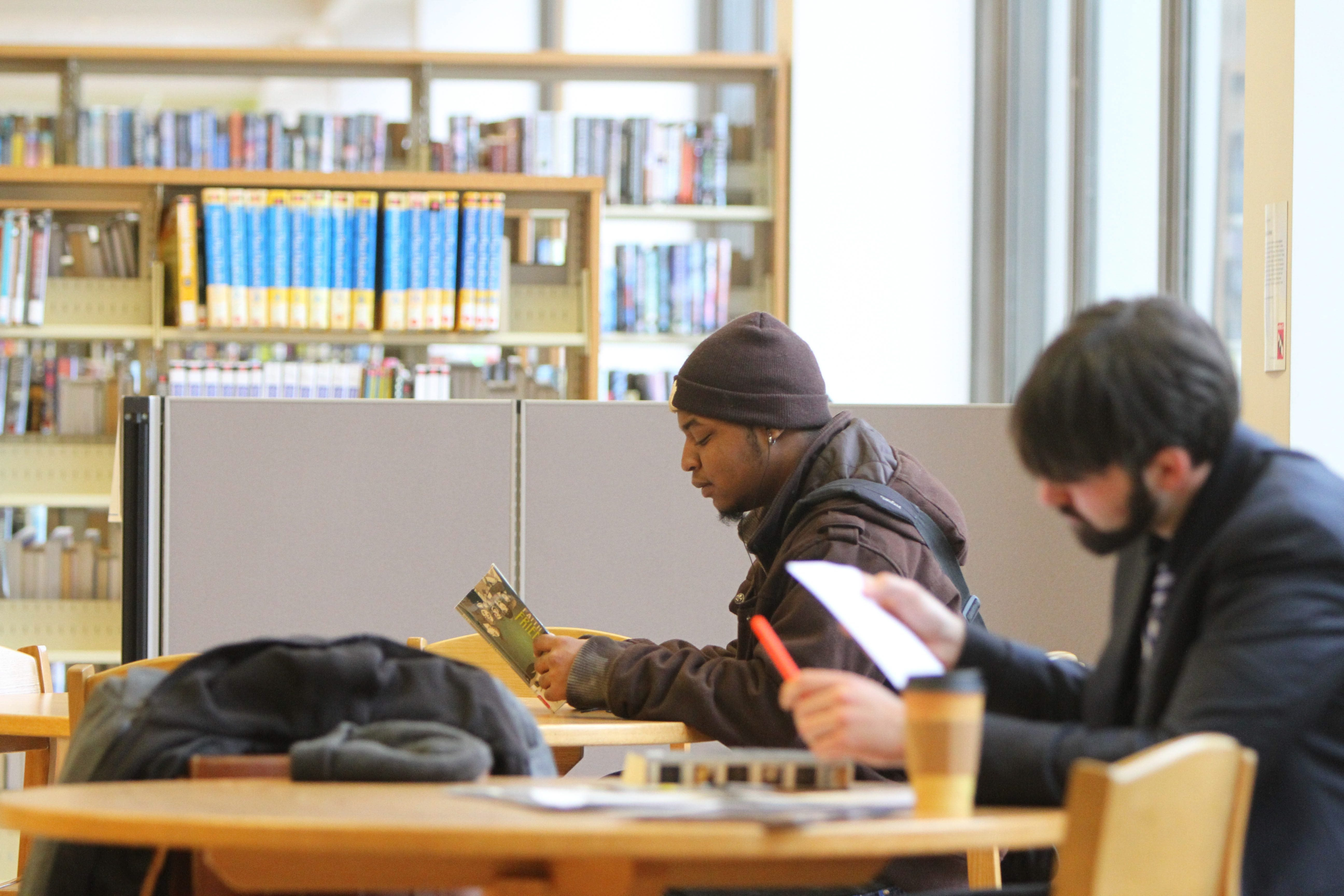 Ryan Sanders, left, of Buffalo, is among Central Library patrons taking advantage of the system's relief from austerity. The director, Mary Jean Jakubowski, favors a referendum to create a taxing district so innovations could be pursued through consistent funding.