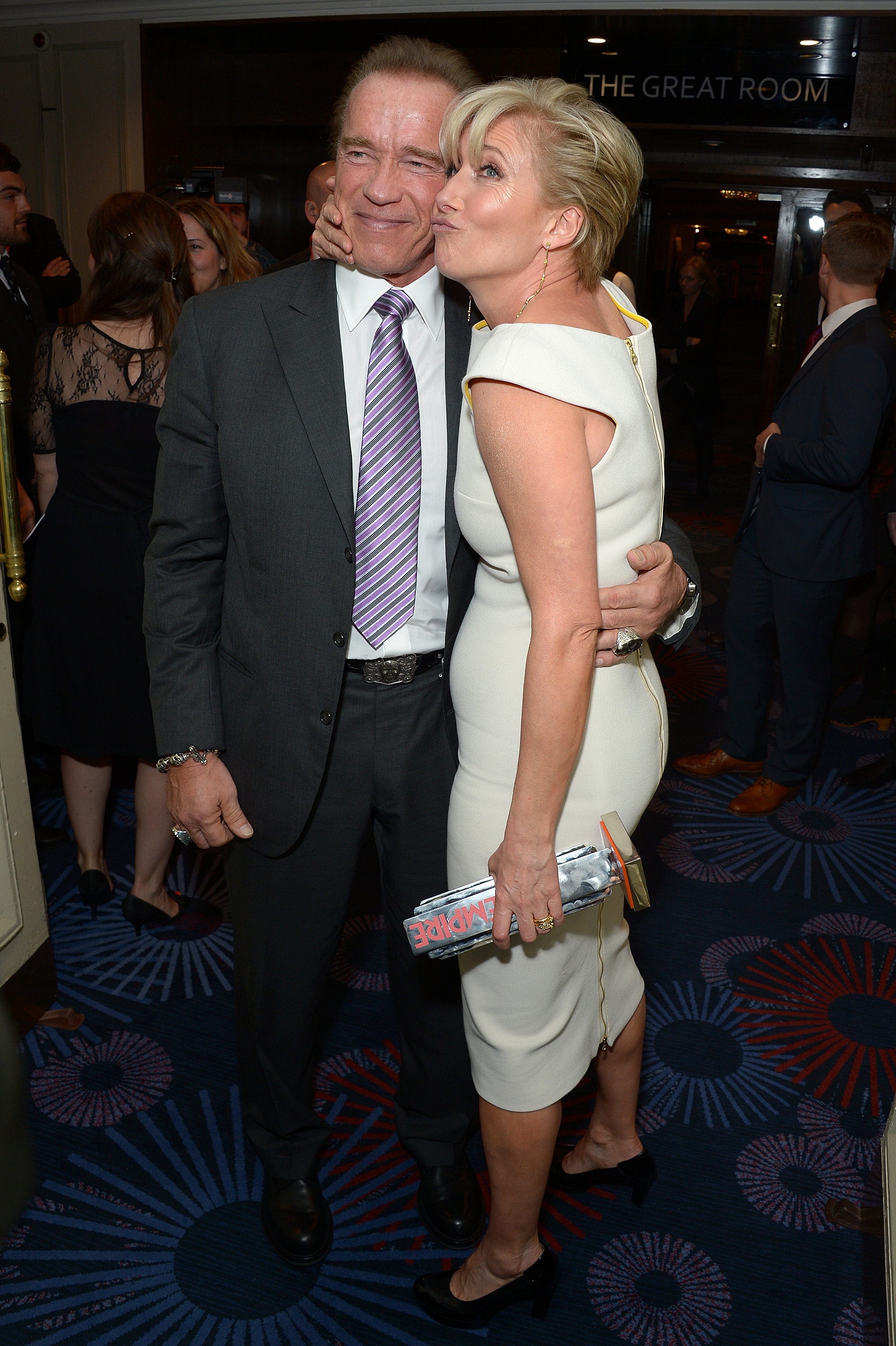 Brawn and beauty: Actors Arnold Schwarzenegger and Emma Thompson mug for the cameras Sunday at London's Grosvenor Hotel during the Empire Awards 2014 celebration.