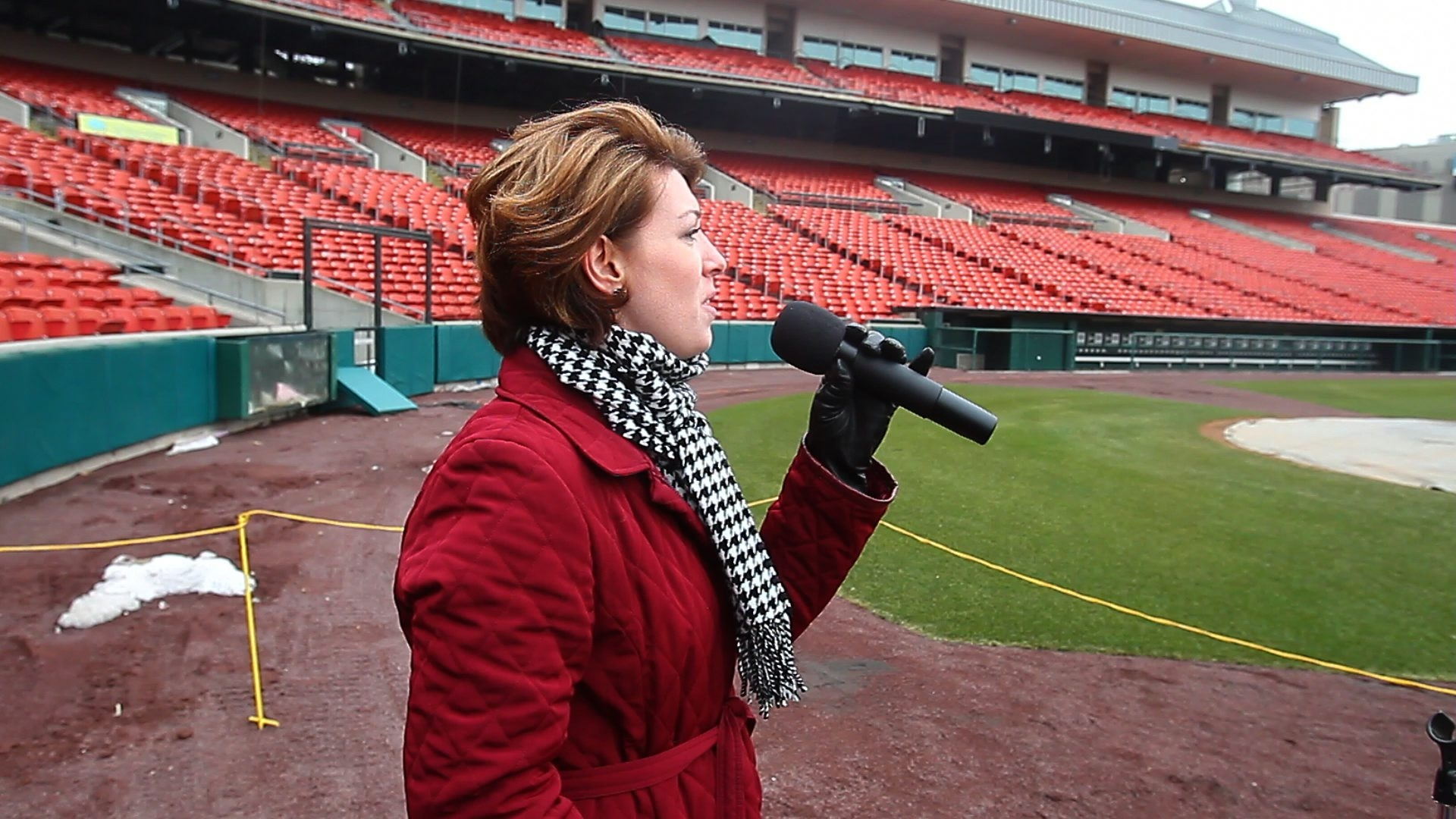 April Sroka of Depew auditions to sing the Canadian and American national anthems for the Buffalo Bisons at Coca Cola Field in Buffalo on Saturday.