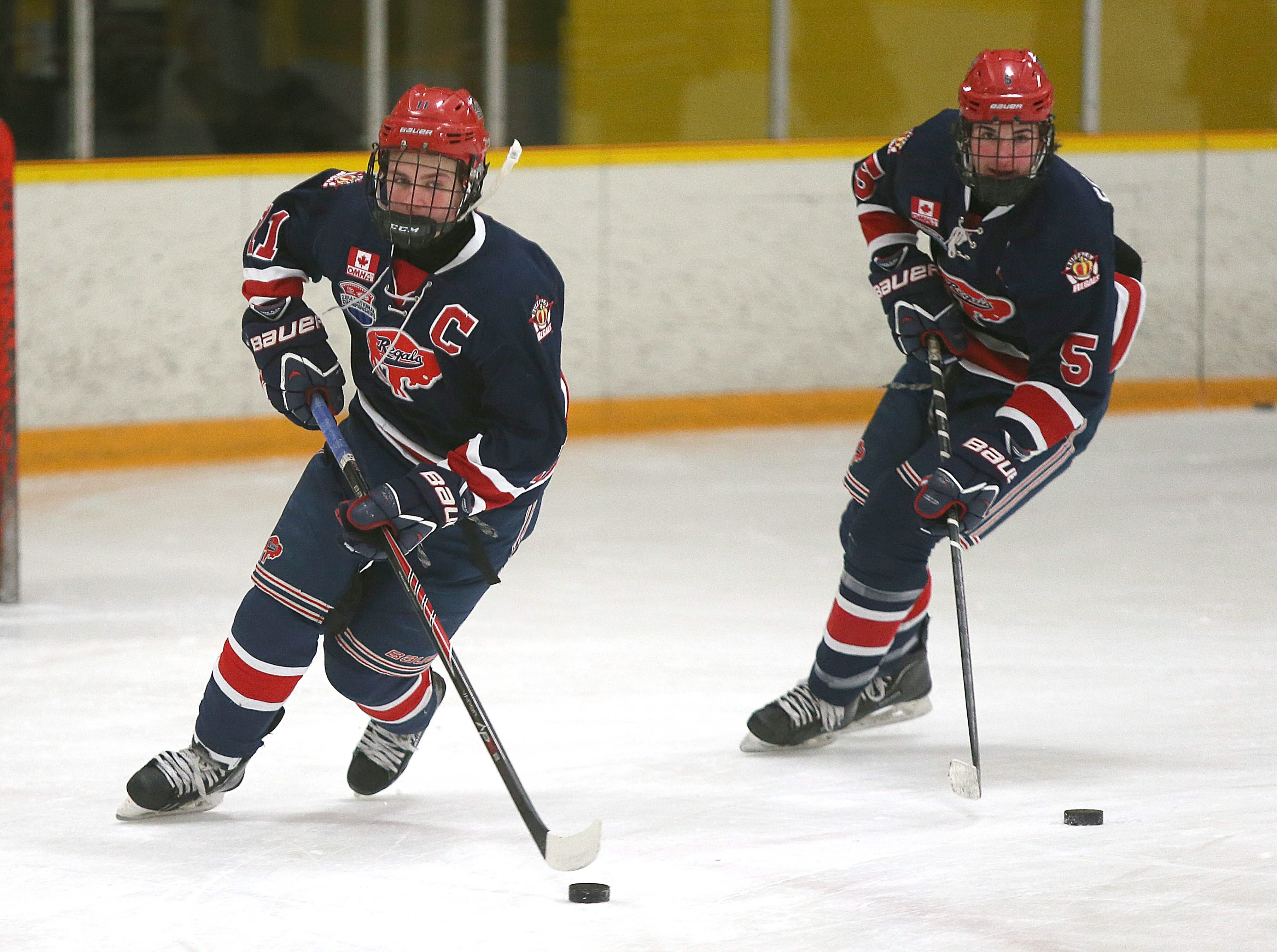 Forward Matthew Gasuik, left,  defenseman Anthony Scanzuso and the Buffalo Regals look to keep the good times rolling in Green Bay at the USA Hockey Championships.