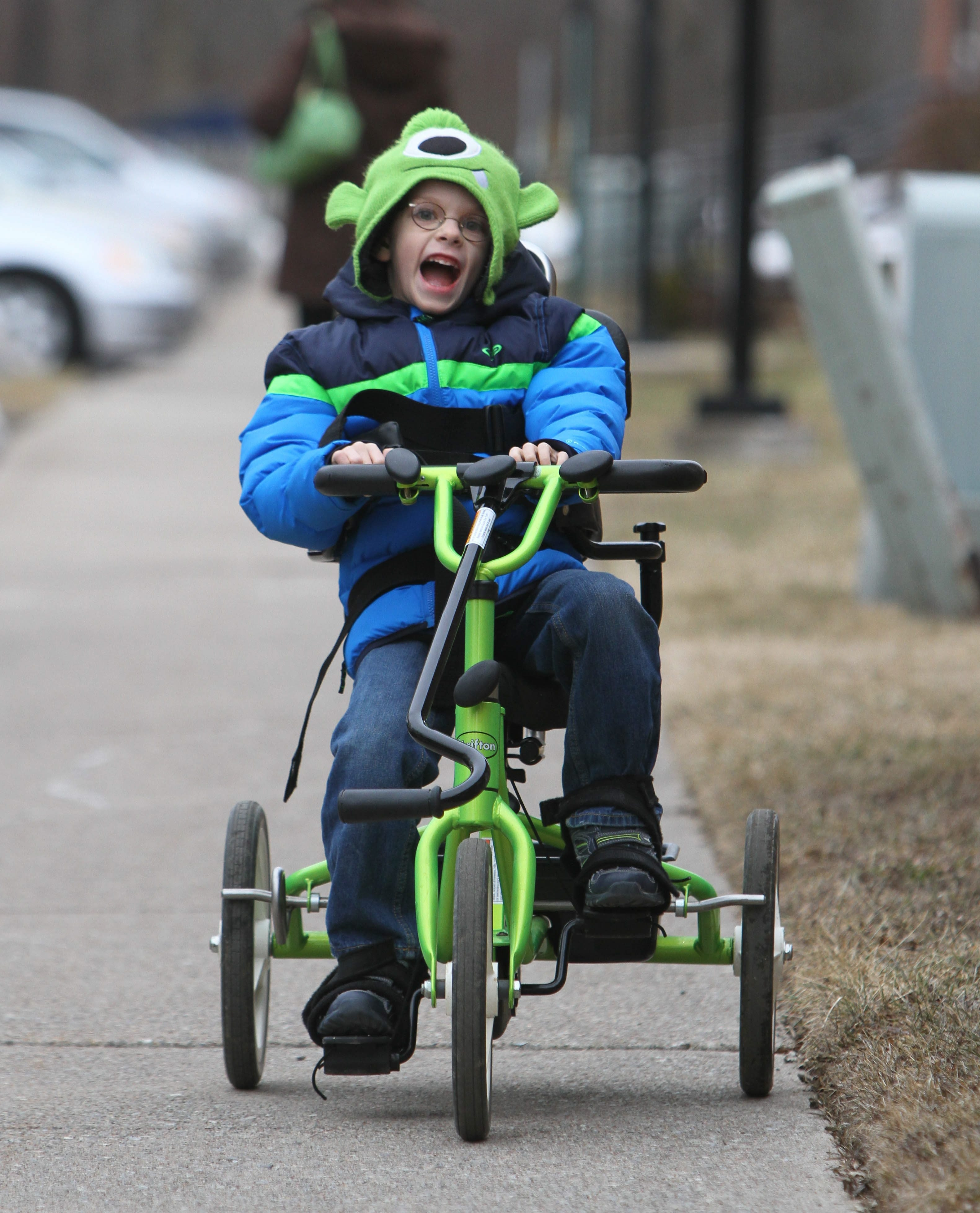 Brandon Steffan, 6, rides his modified tricycle at his Amherst home.
