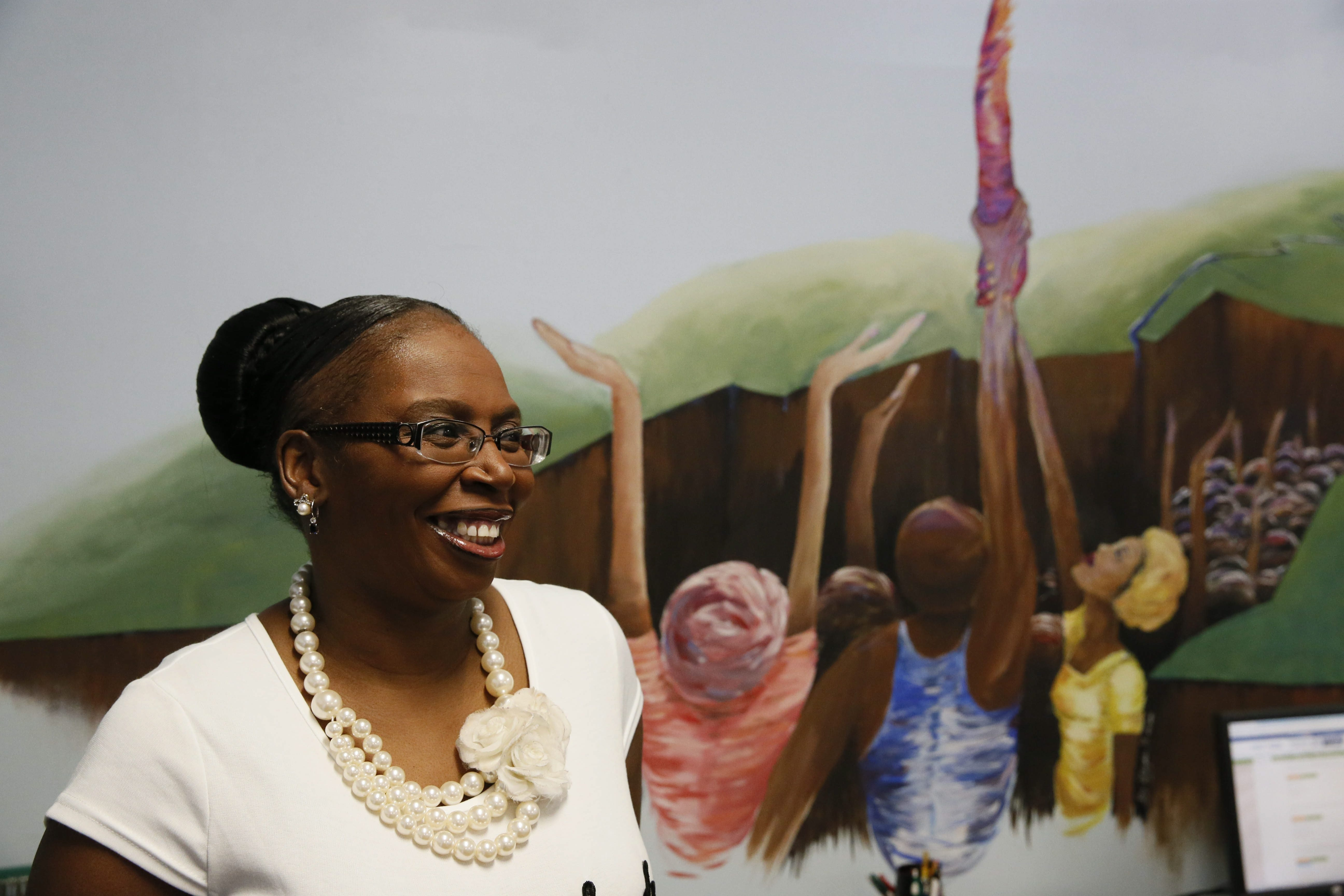 """""""The refugees look at me as the mother of Vive, down to the 70- and 80-year-olds. They tell me that I – a person of color and an educated woman – stand for what they are trying to be."""" – Angela Jordan-Mosely, executive director of Vive La Casa"""
