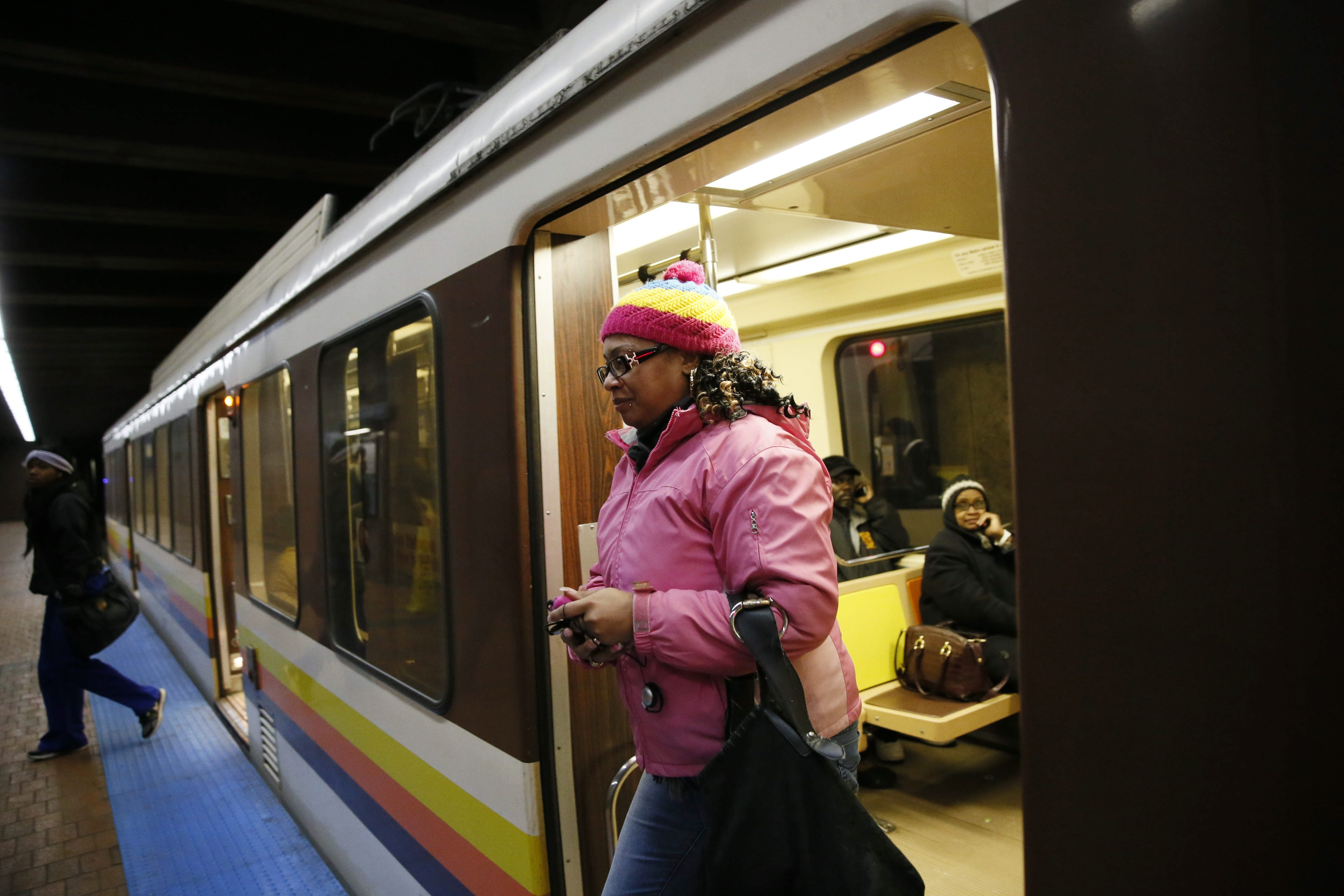 Teraysa Smith, a senior medical biller at Roswell Park Cancer Institute, walks off the Metro Rail at the Medical Campus Station on her way to work early Tuesday. Smith, like other commuters, considers the 20-minute delays in train frequency inconvenient.