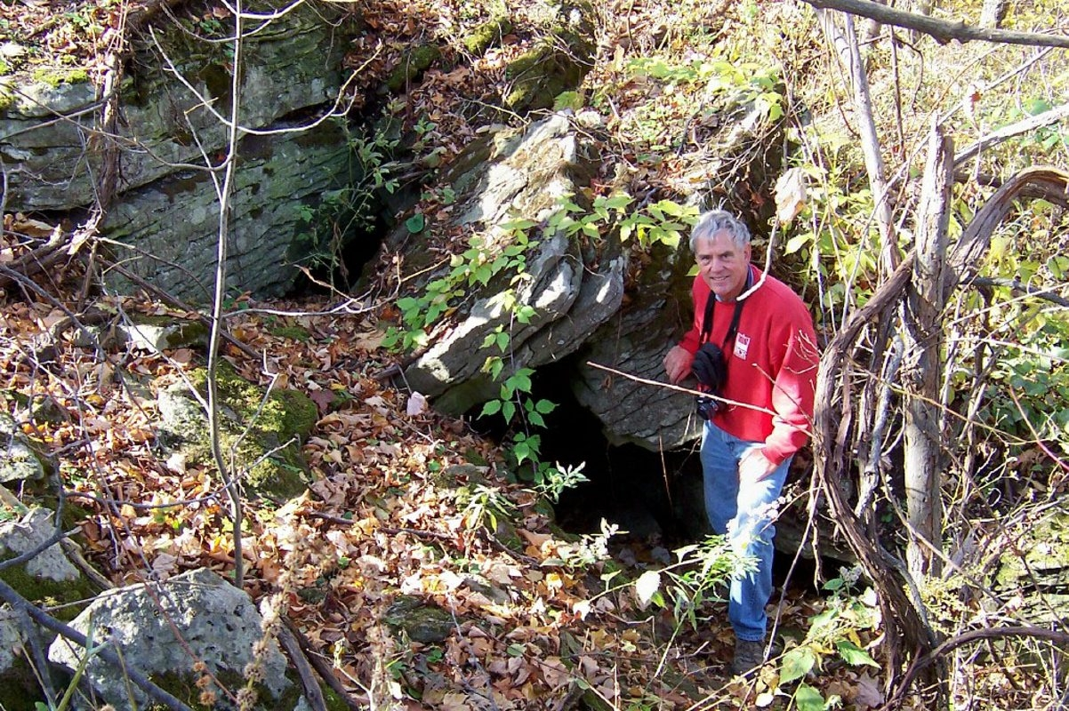 """Local researcher Lloyd Draper gets down in the weeds at Kienuka, which in Seneca language means """"fort,"""" built by the tribe during what in Europe was then the Middle Ages."""