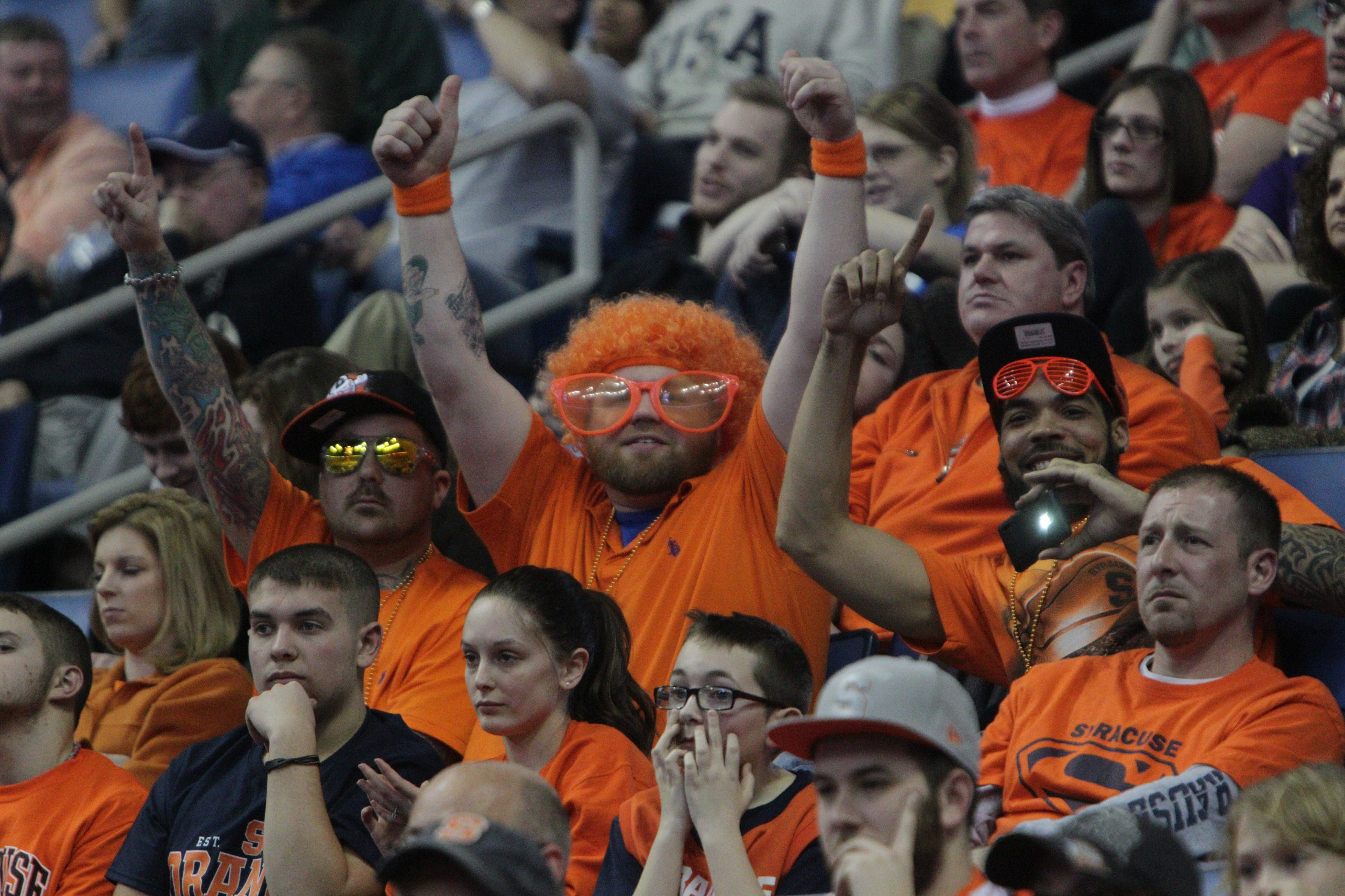 Syracuse fans cheer for their team during the second half of the game against Western Michigan in the men's NCAA college basketball tournament at First Niagara Center, Thursday, March 20, 2014.  (Sharon Cantillon/Buffalo News)