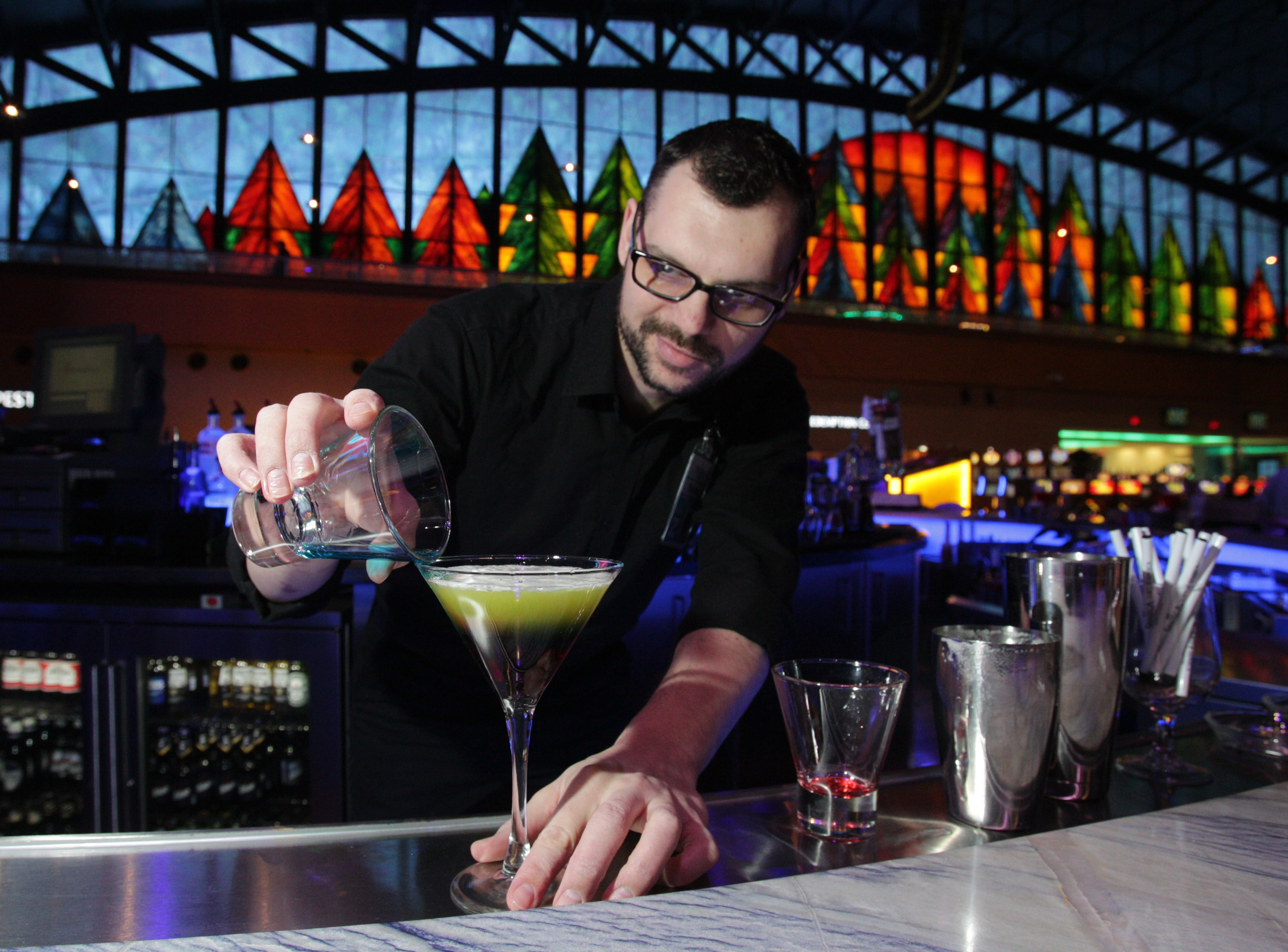 Bartender Devin Sutherland makes the Man Overboard, a three-layered drink, in Stir.
