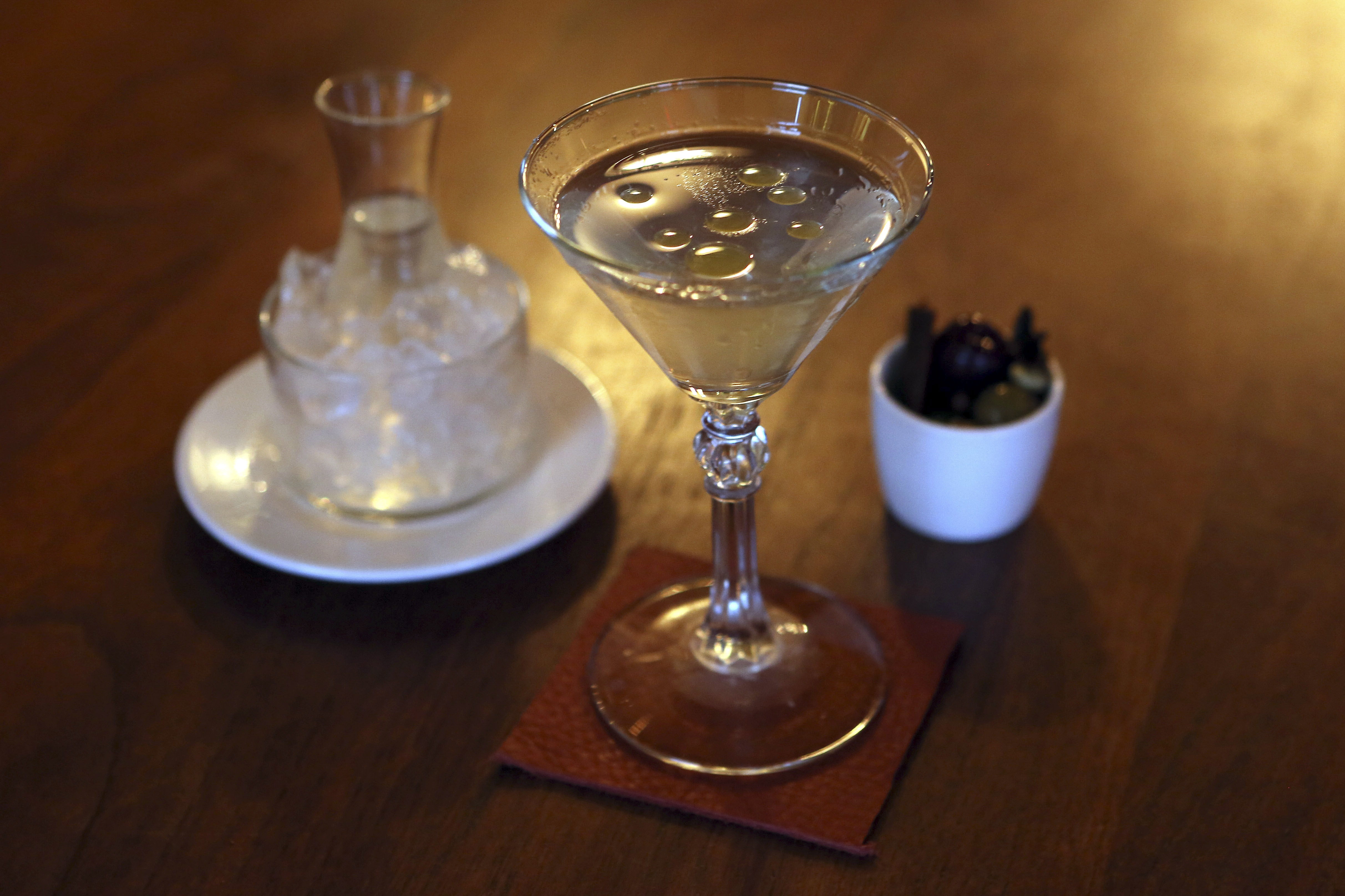 Seven different forms of olives go into the Olives 7 Ways martini at Saxon & Parole in New York City.
