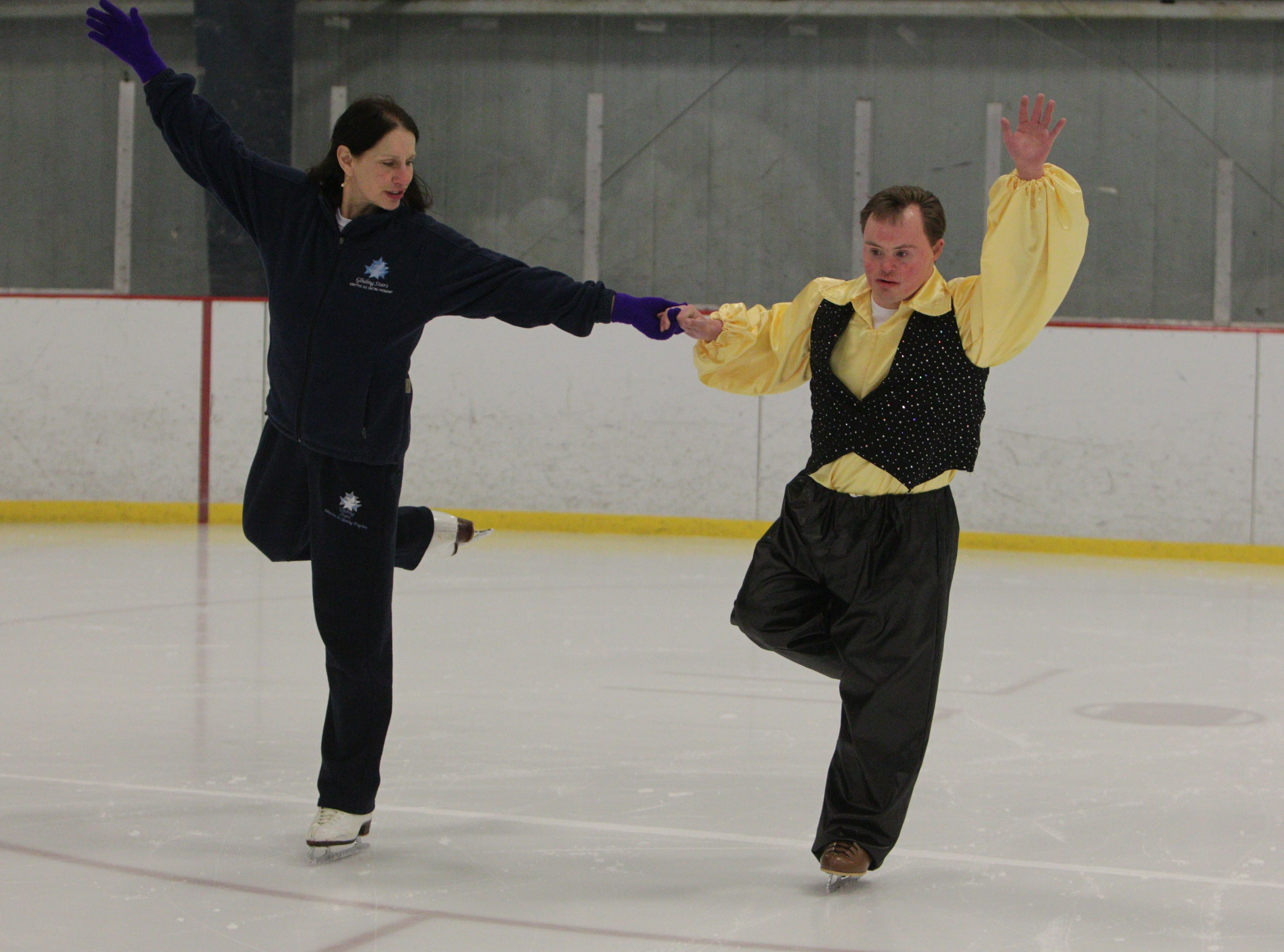 Alex May skates with Gliding Stars director and founder Elizabeth O'Donnell on Sunday in Hyde Park Arena in Niagara Falls. May will perform his first solo skate at this weekend's show.