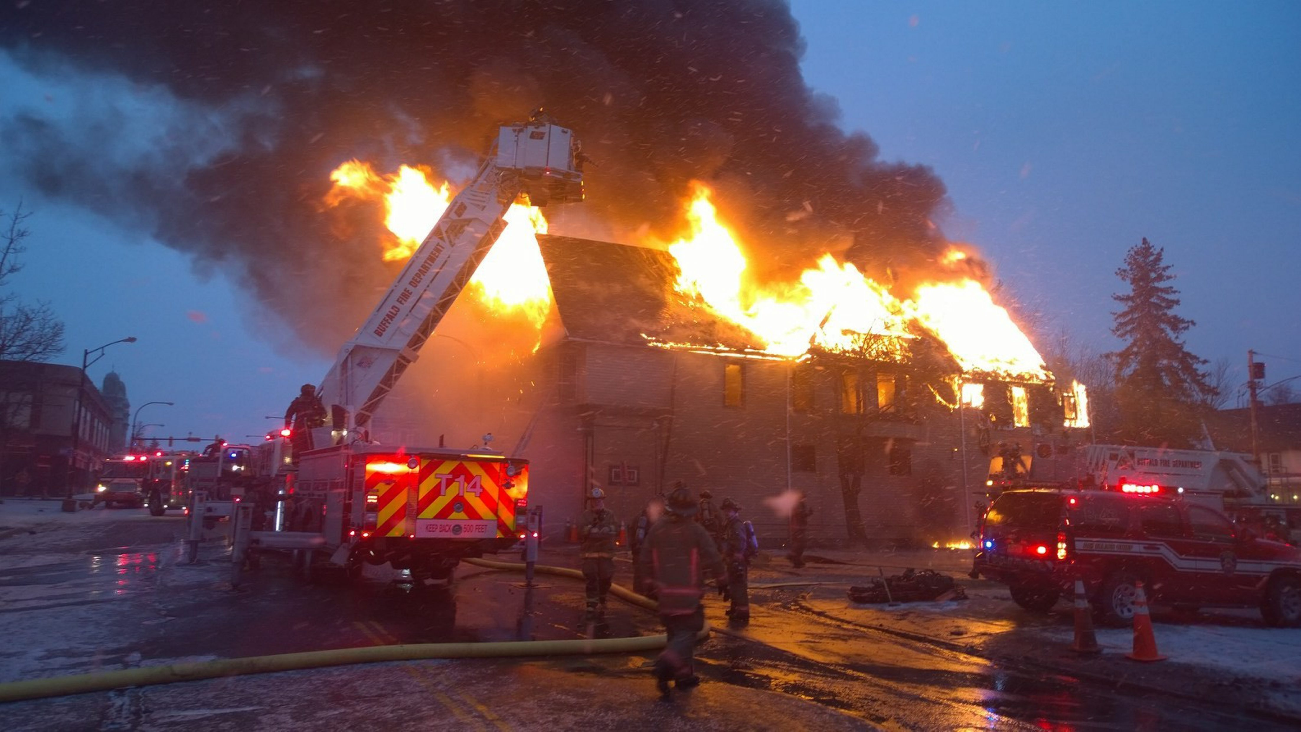Buffalo firefighters try to douse flames from a blaze that engulfed this house at 1400 Fillmore Ave. and claimed one life just before 7 a.m. today.