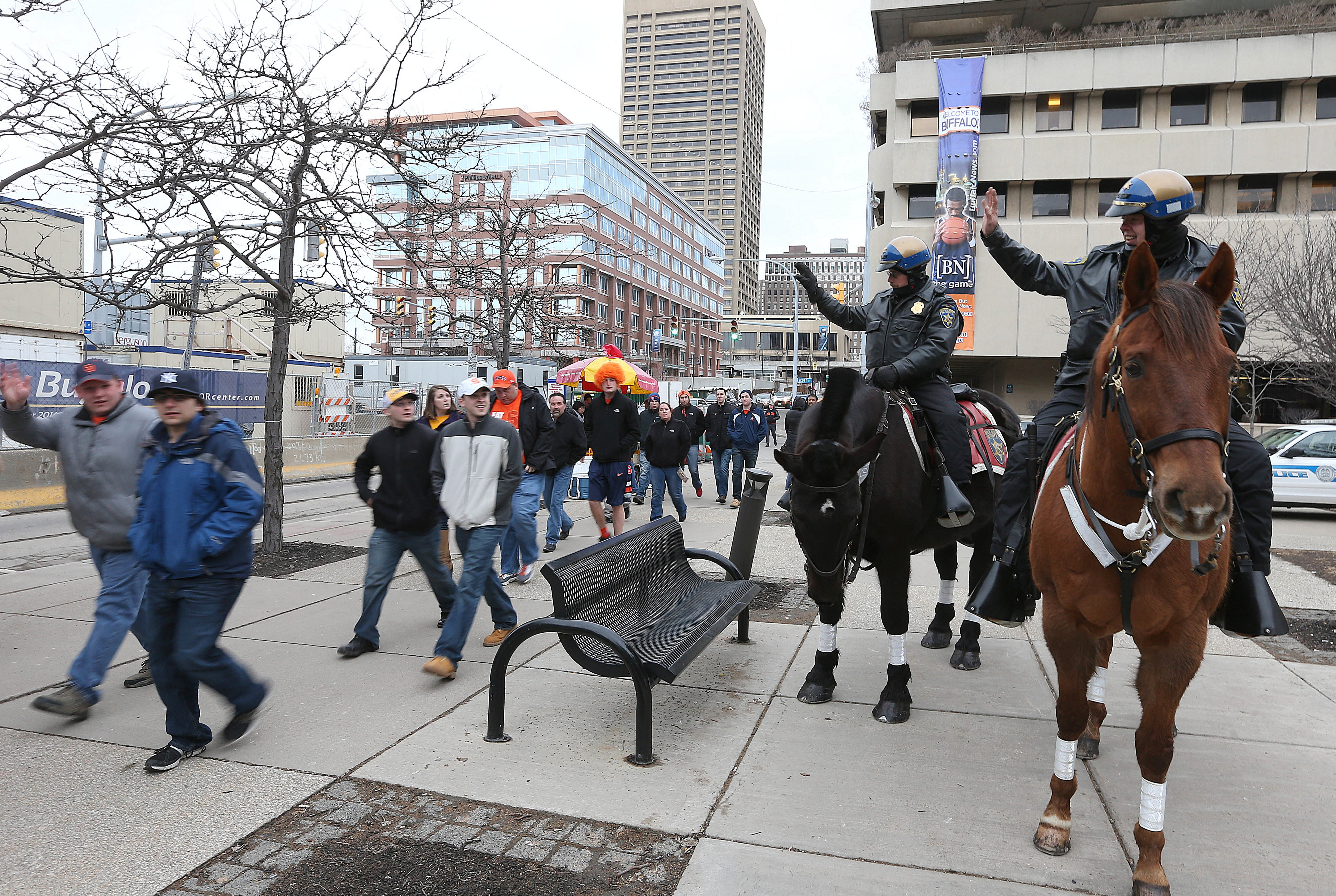 Mounted patrolmen from the Erie County Sheriff's Office greeted NCAA fans on their way to First Niagara Center for the men's basketball tournament Saturday.