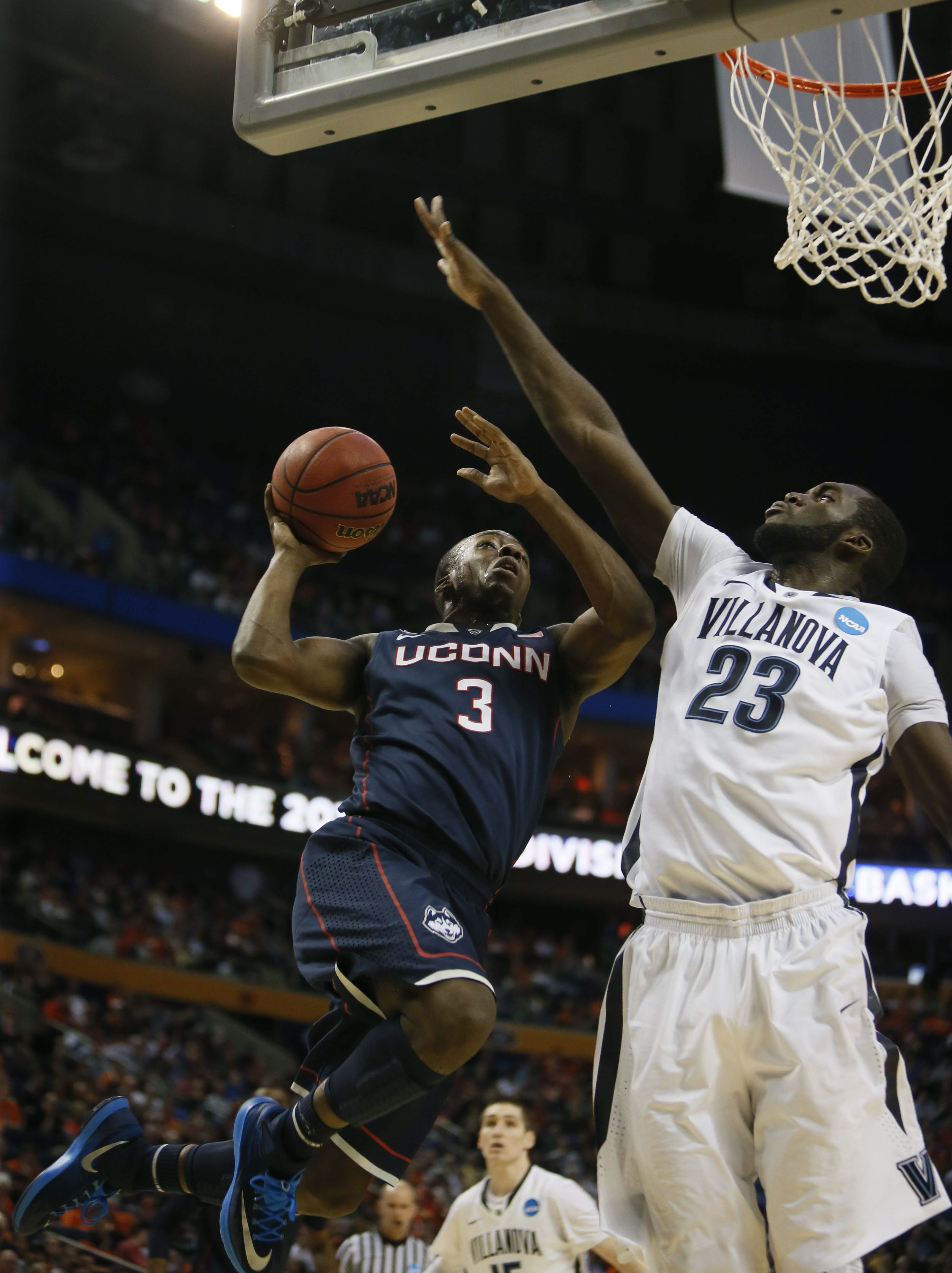 UConn's Terrence Samuel goes up for a shot against Villanova's Daniel Ochefu during the first half of Saturday's game. UConn erased a 10-point deficit to earn the victory.