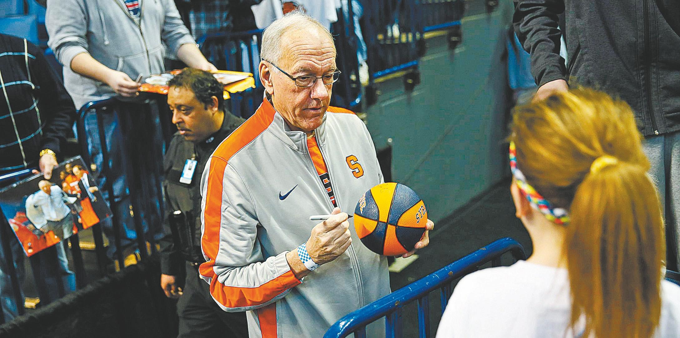 Syracuse coach Jim Boeheim signs autographs during Wednesday's practice. (Derek Gee/Buffalo News)