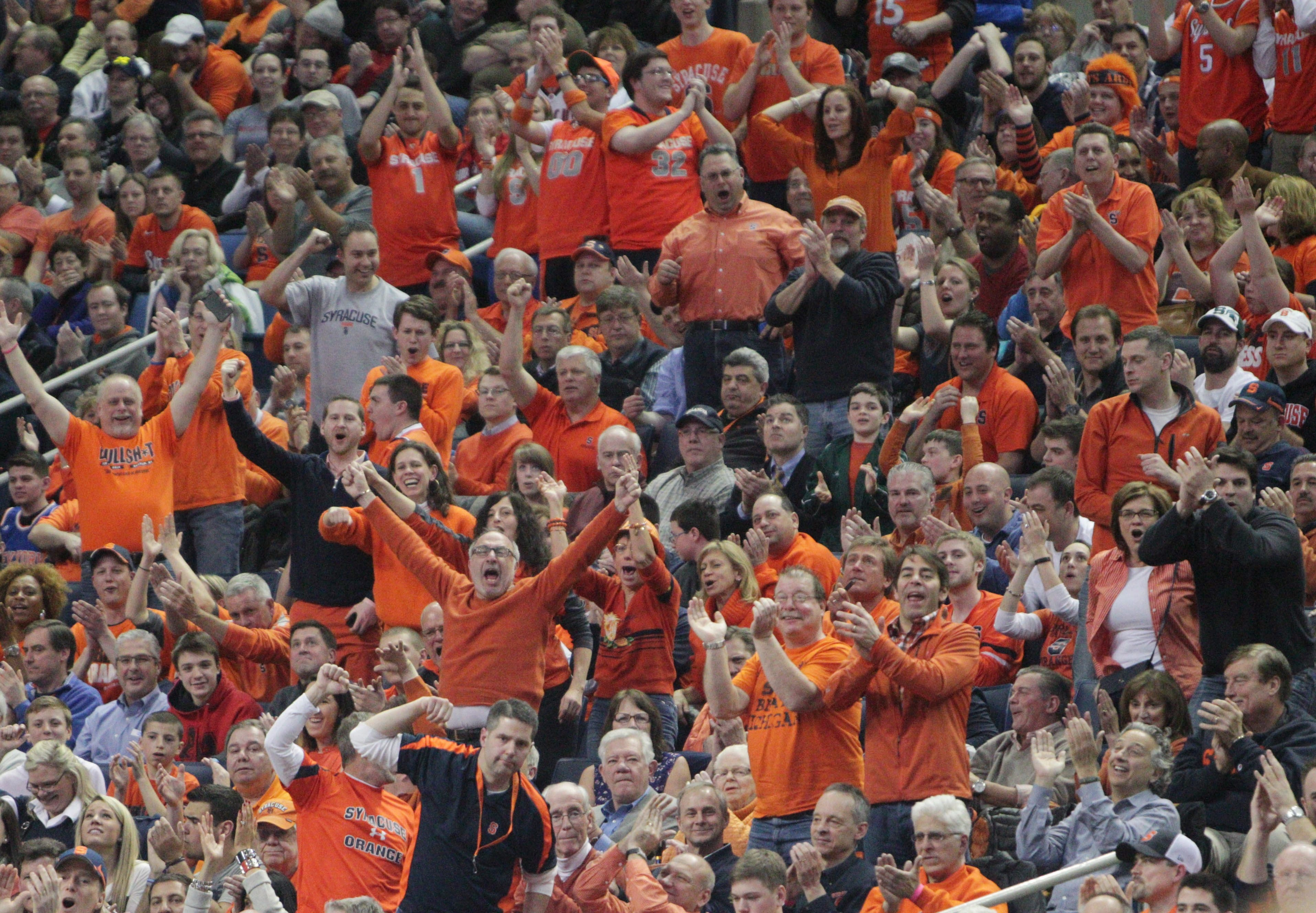 Syracuse fans cheer on their team in the game at First Niagara Center on Thursday.