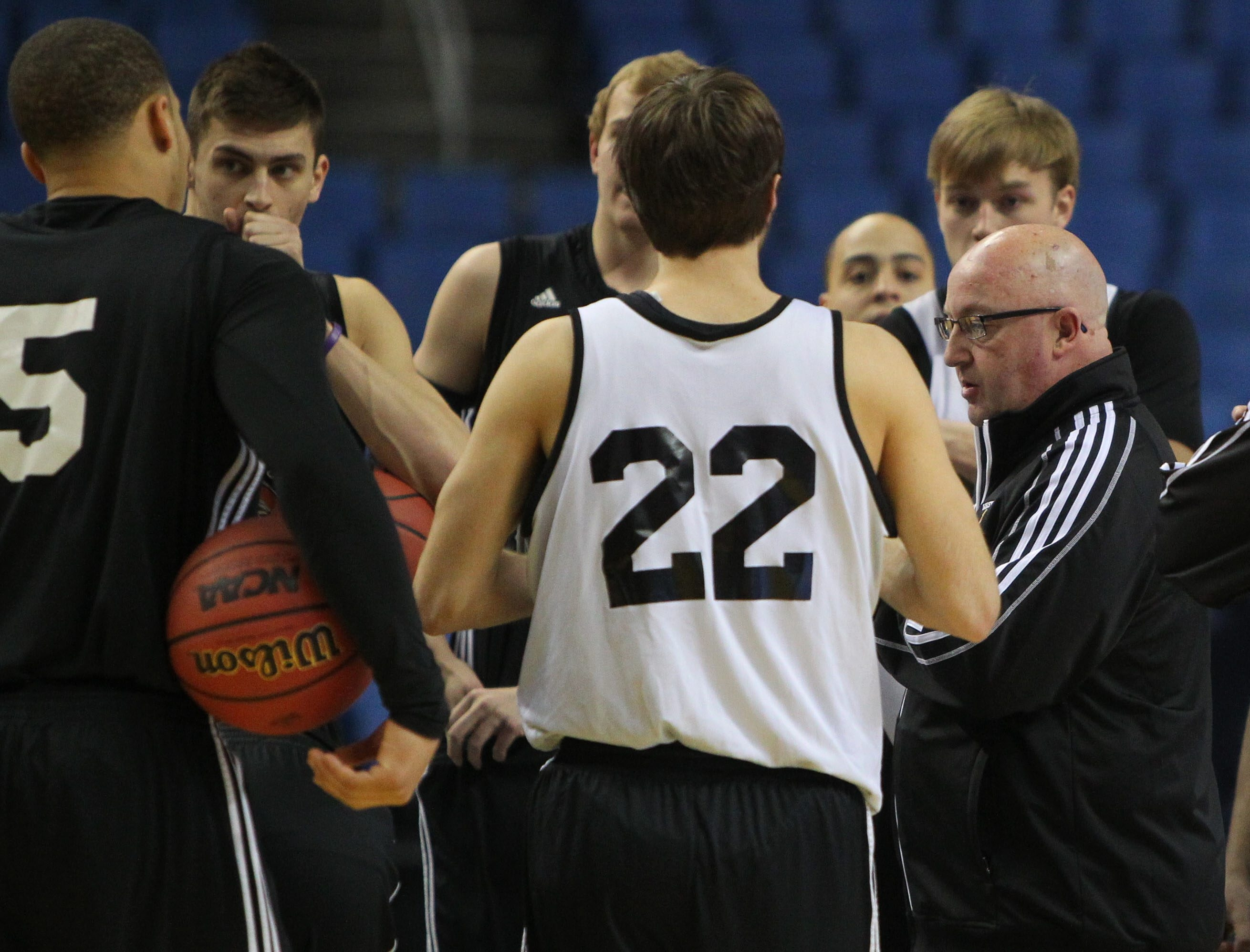 Western Michigan coach Steve Hawkins talks with his players during practice Wednesday in First Niagara Center.
