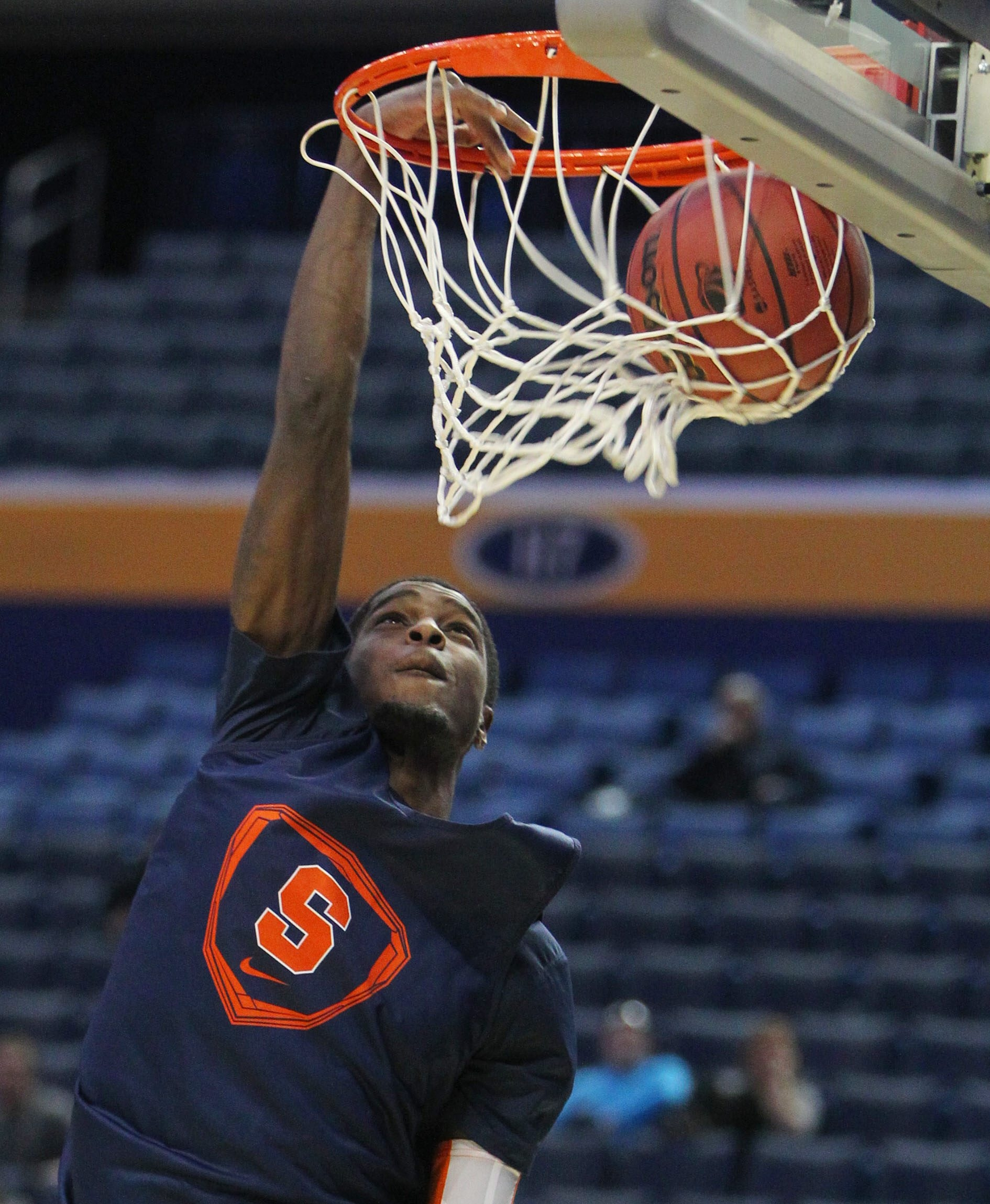 B.J. Johnson of Syracuse goes to the basket for a jam during practice at First Niagara Center.