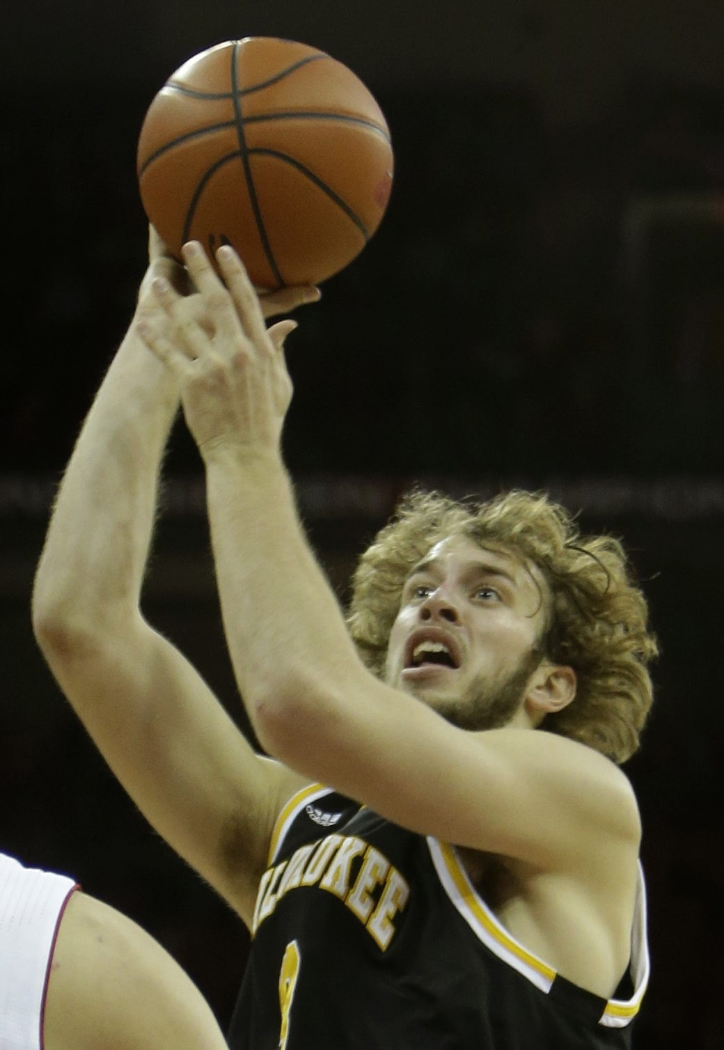 Kyle Kelm of the University of Milwaukee Panthers pulls up for a jump hook against the Wisconsin Badgers on Dec. 11.