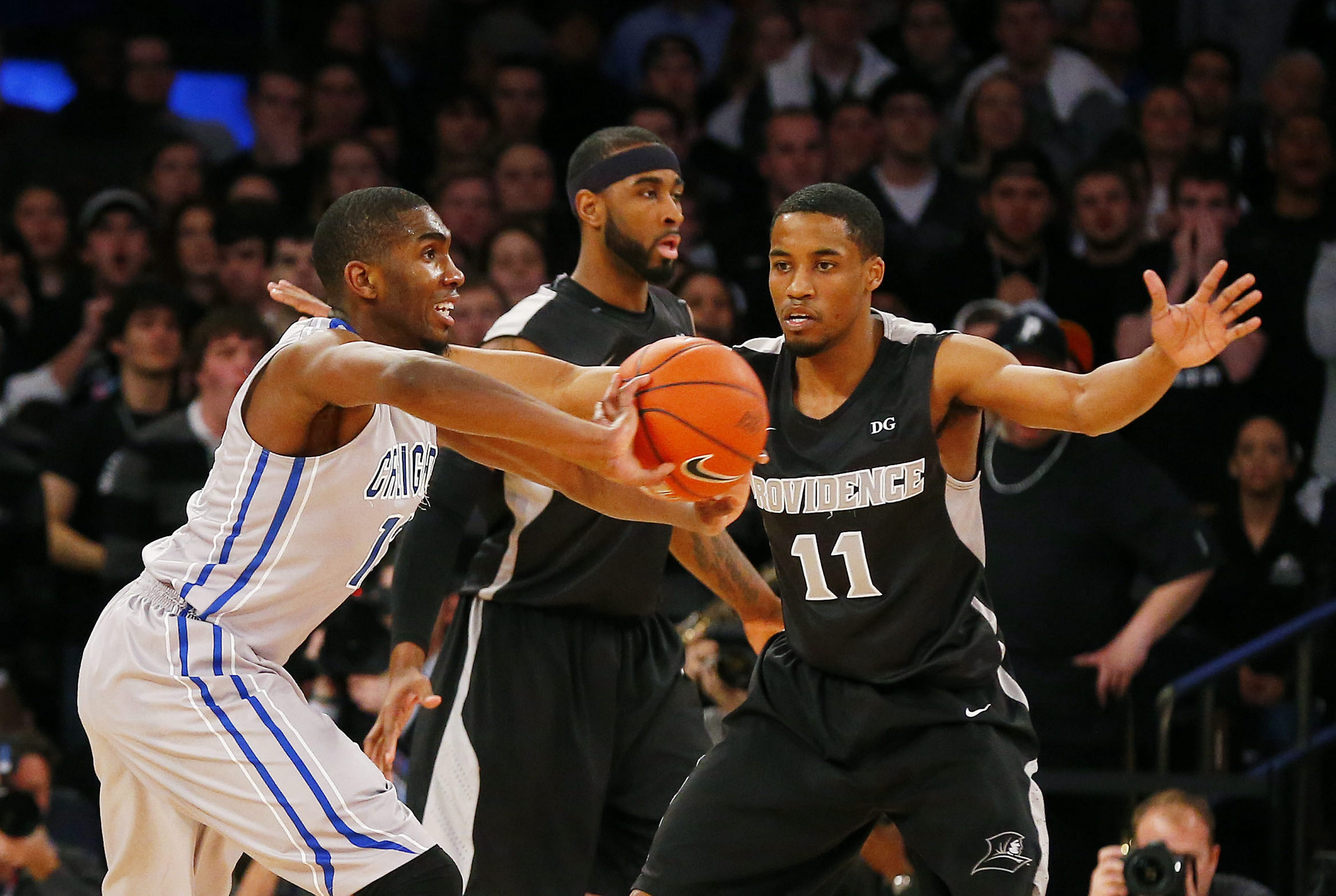 Bryce Cotton of Providence, defending Jahenns Manigat of  Creighton, averages 39.9 minutes a game.