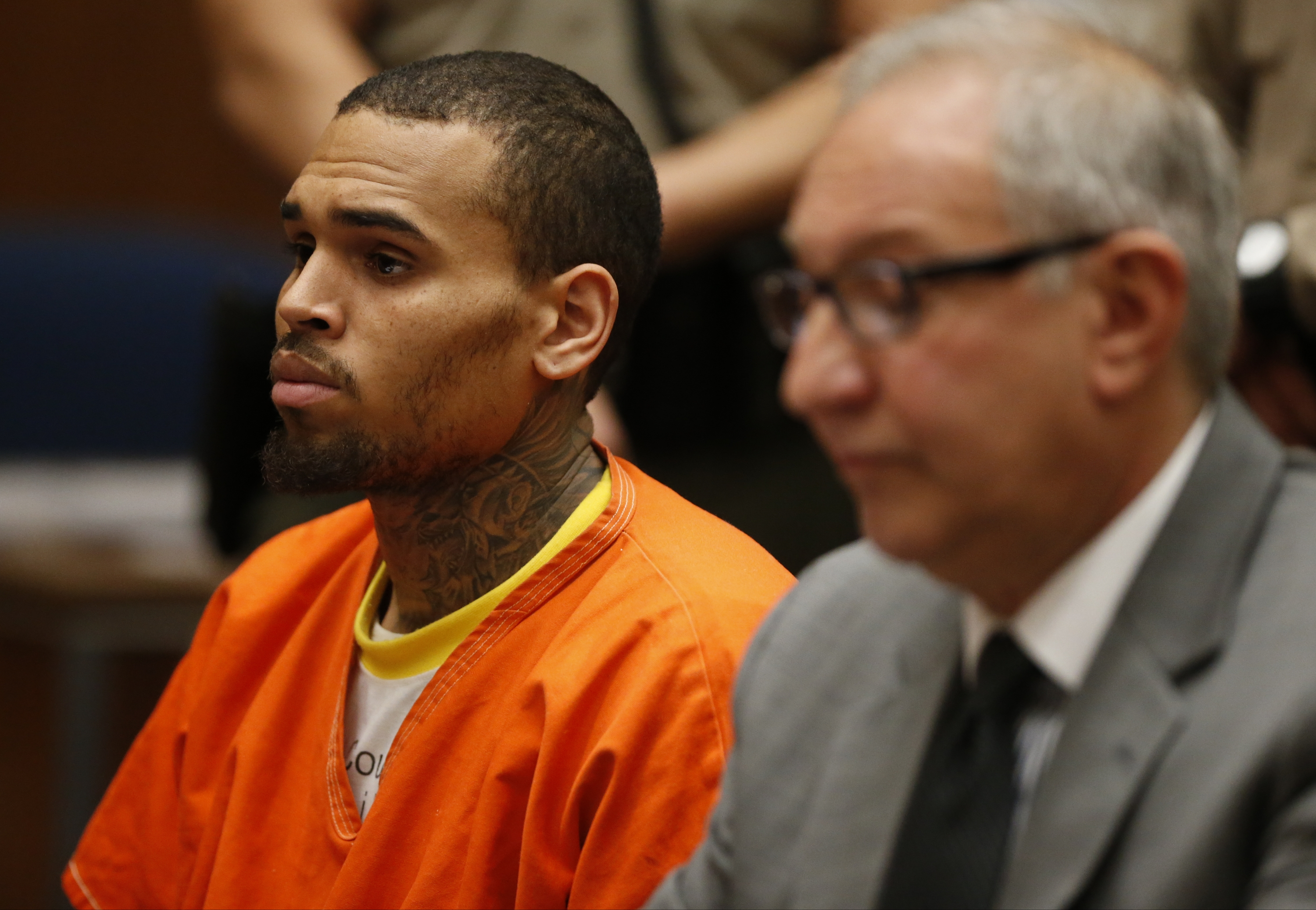 R&B singer Chris Brown, left, appears in Los Angeles Superior Court with his attorney Mark Geragos on Monday and was ordered to remain in jail.