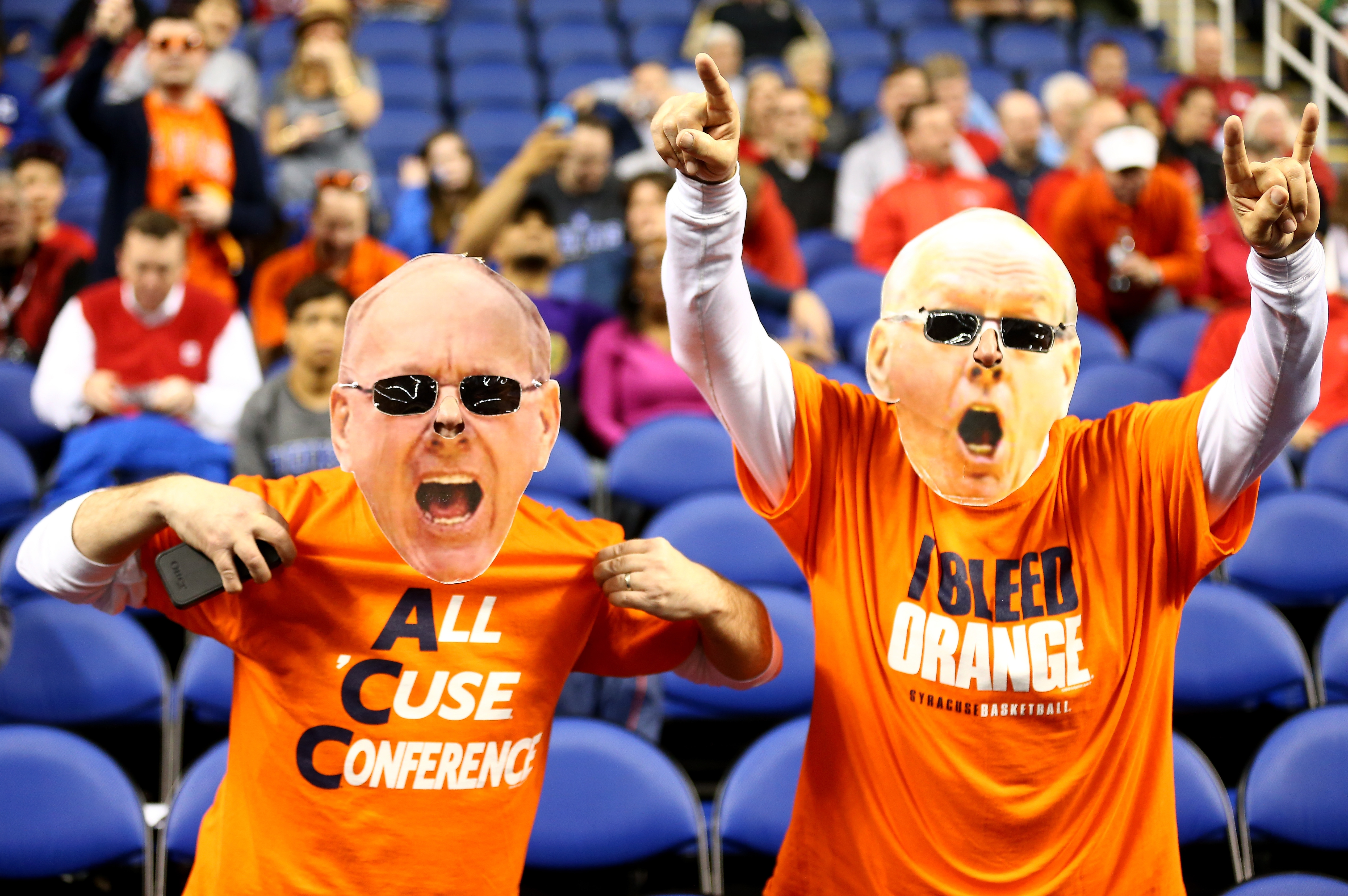 Fans of the Syracuse Orange cheer on their team before the March 14 game against North Carolina State in the quarterfinals of the 2014 Men's ACC Basketball Tournament.