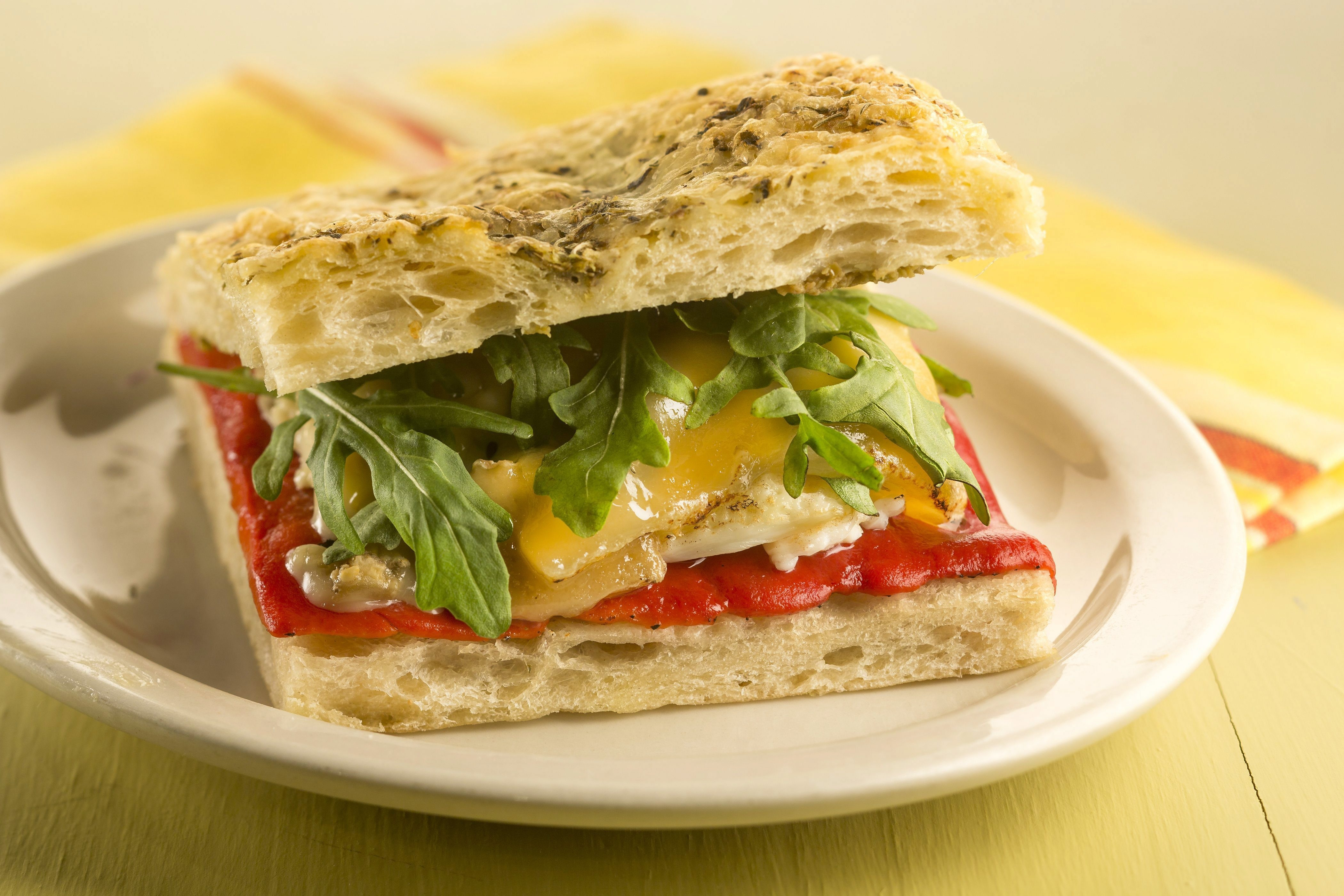 When Lenten observances demand a meatless meal, the pepper and egg sandwich is a favorite for its fat strips of sauteed green bell pepper nestled into mounds of fluffy scrambled eggs, all tucked into a crusty roll.