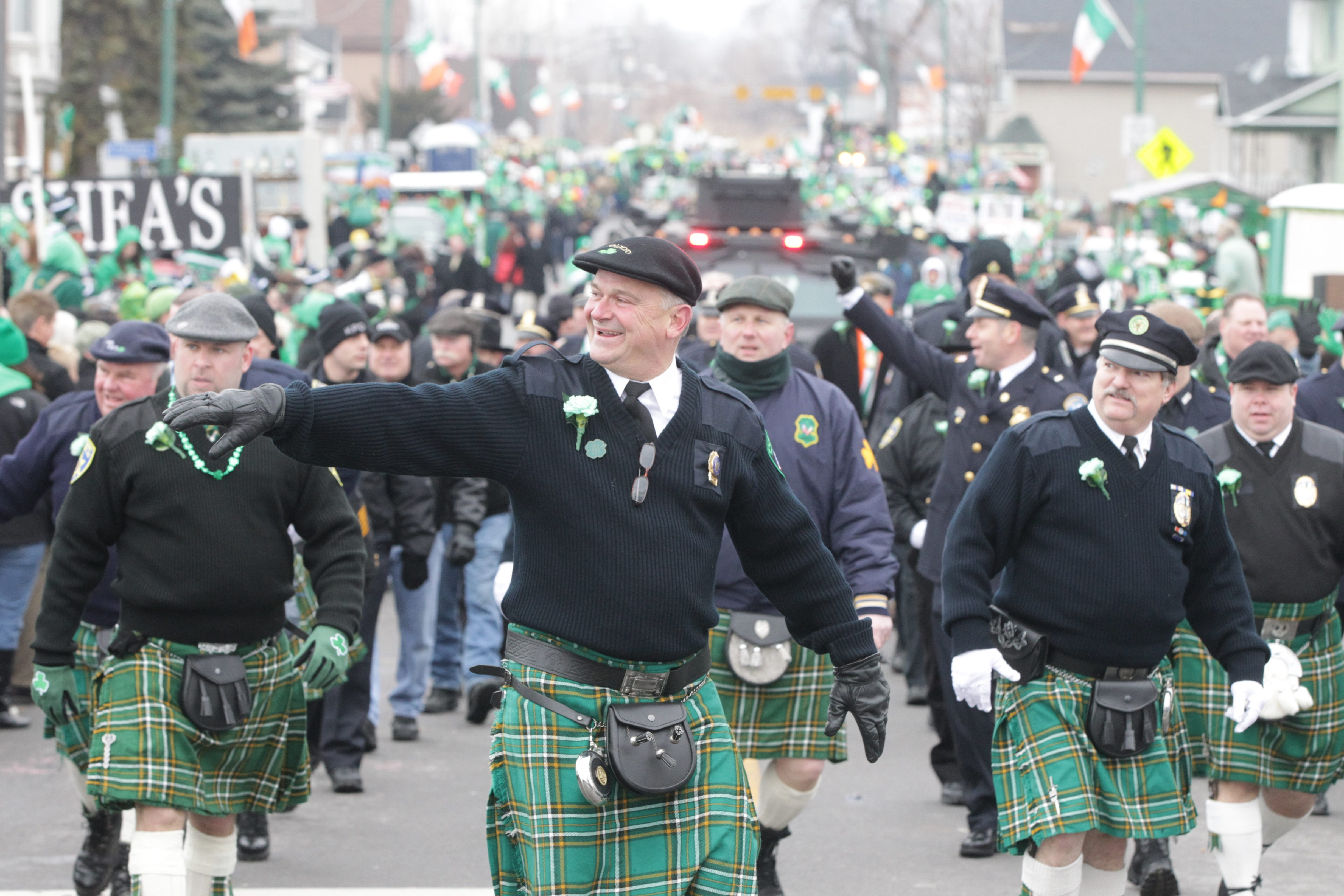 The Old First Ward is awash in all shades of green – and plenty of plaid – Saturday as thousands enjoy the Old Neighborhood Parade.