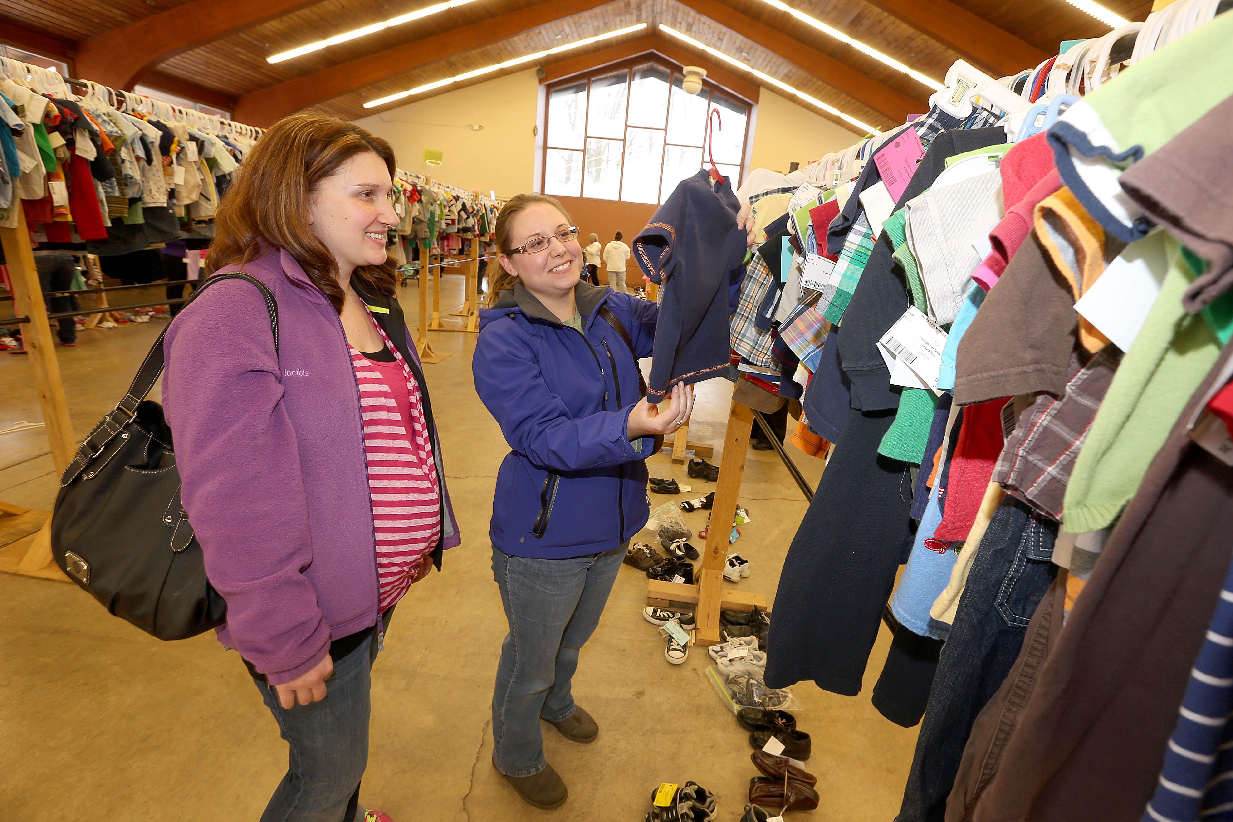 Future mother Claudia Kochman, left, shops at the Buffalo Baby Expo with friend Samantha Niwinski on Saturday.