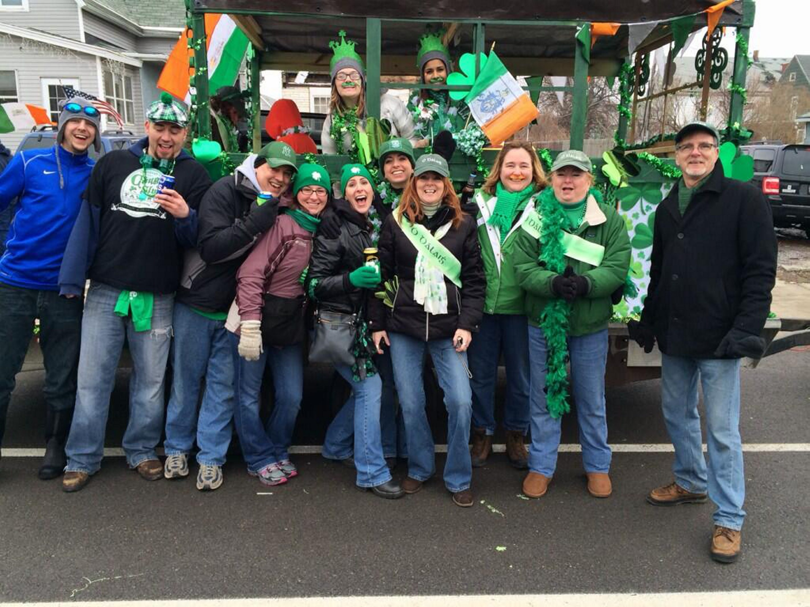 The Daley family enjoys the St. Patrick's Day Parade as it winds its way Saturday through the Old First Ward.