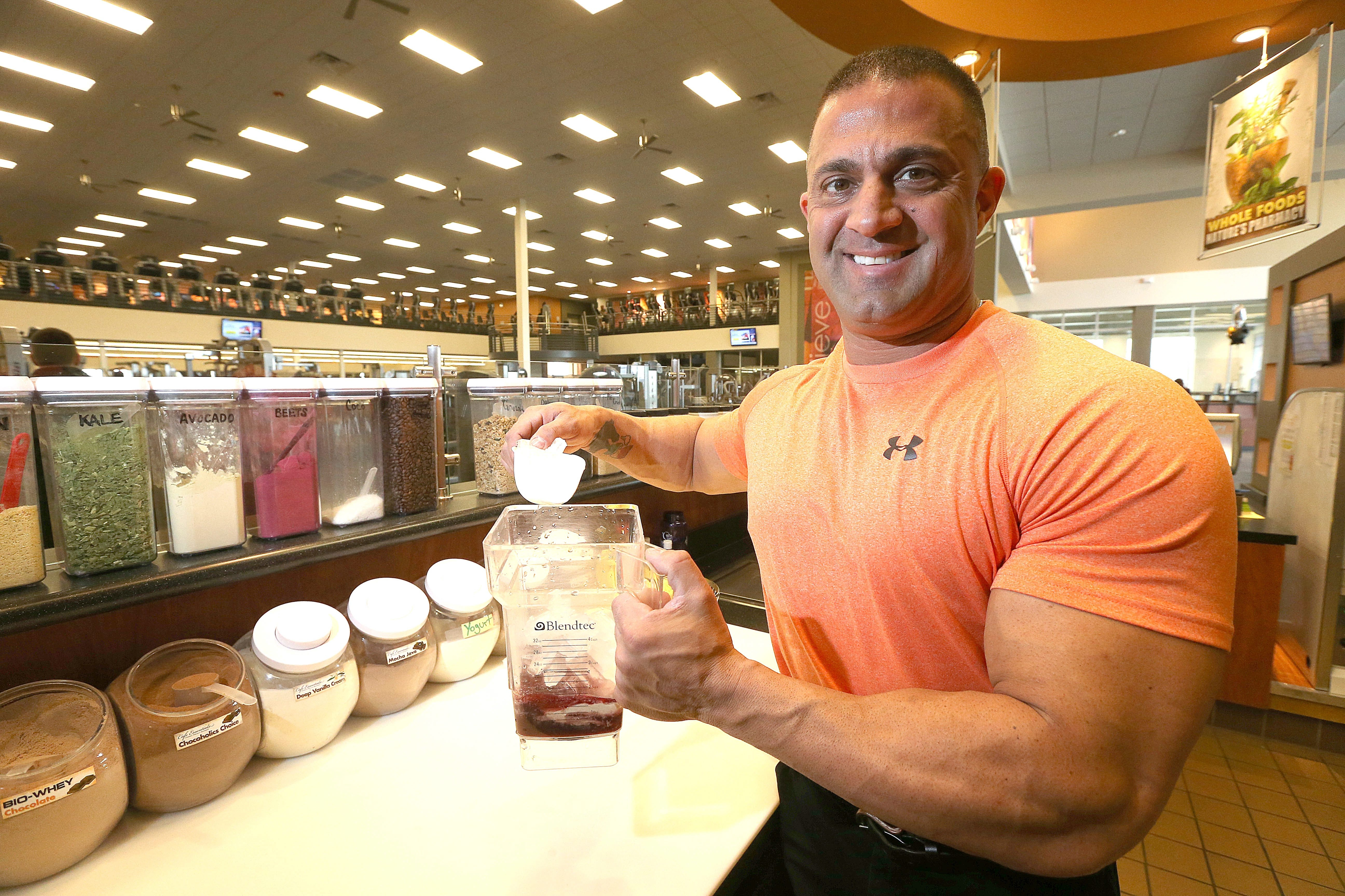 Vinny Di Re Jr. at All Juiced Up! mixes up a protein shake called a Vanilla Berry Parfait at his LA Fitness nook on Elmwood Avenue.