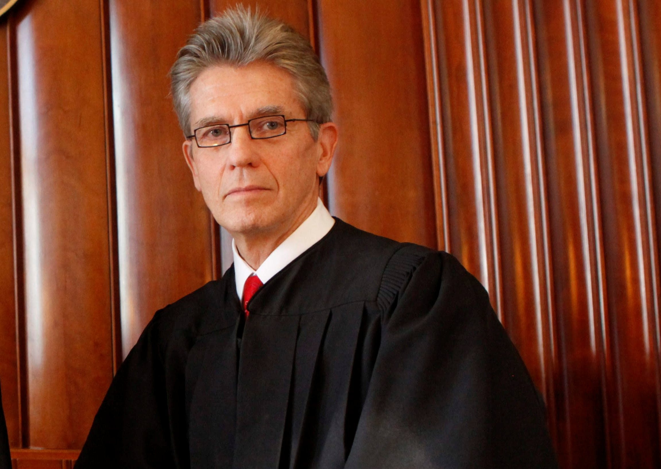 Chief U.S. District Judge William M. Skretny issued a restraining order against 13 companies engaging in abusive collections practices. (Buffalo News file photo)