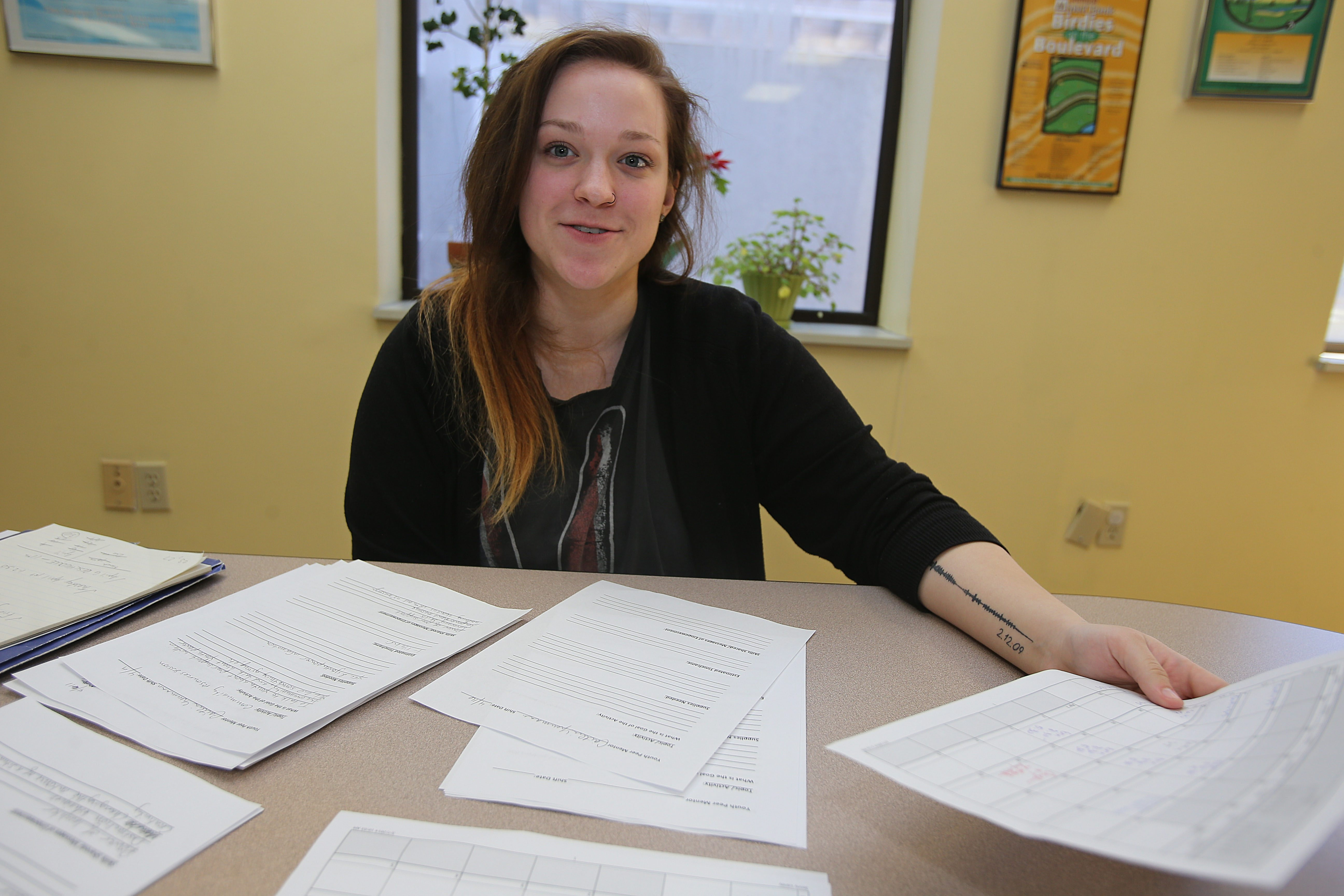 Caitlin Neumann, working at the Mental Health Association of Erie County, Inc. offices in Buffalo, Friday, March 7, 2014. (Charles Lewis/Buffalo News)