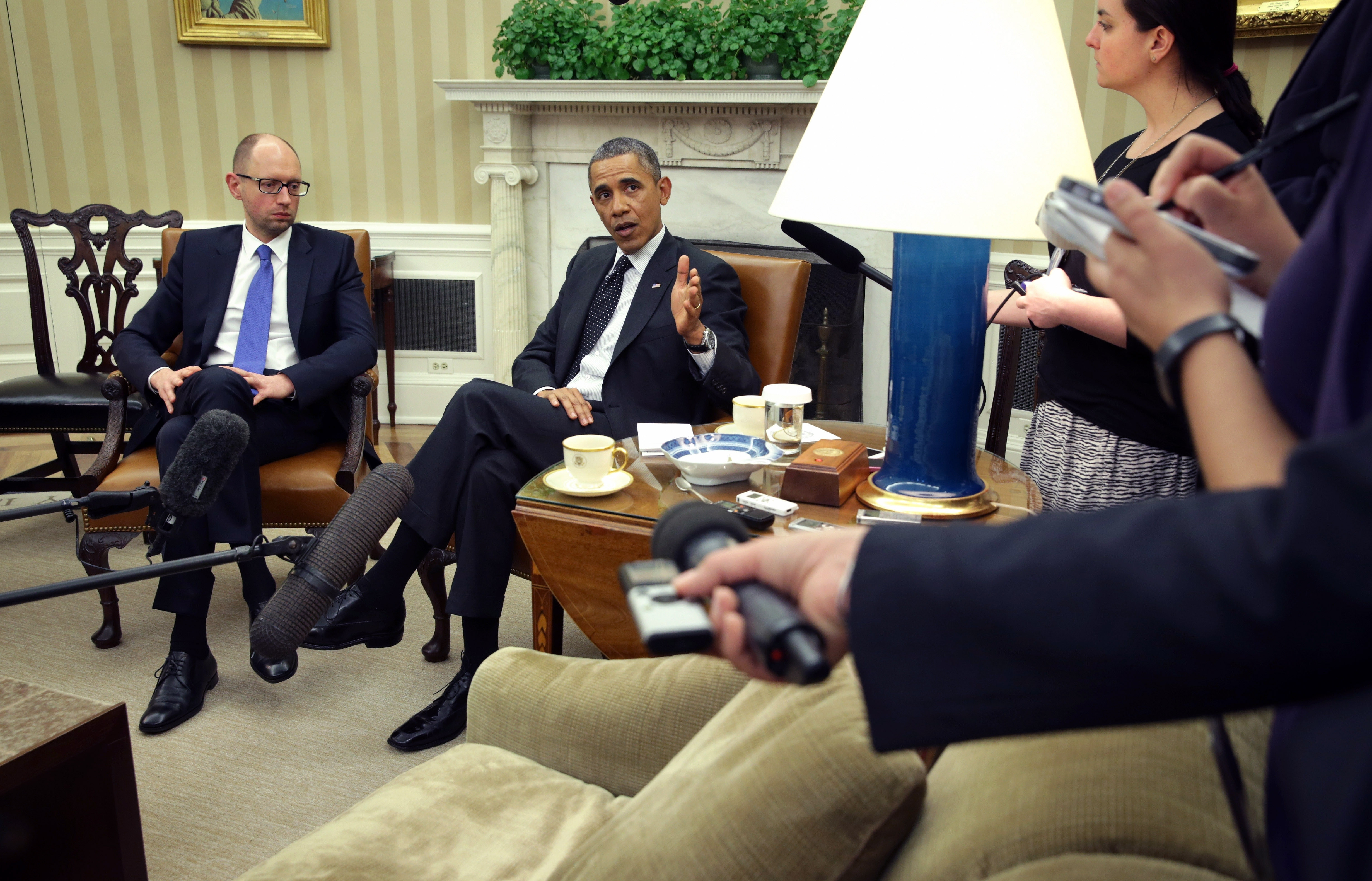 President Obama speaks during Oval Office meeting with Ukraine Prime Minister Arseniy Yatsenyuk, warning again of consequences for Russia if it does not withdraw from Crimea.