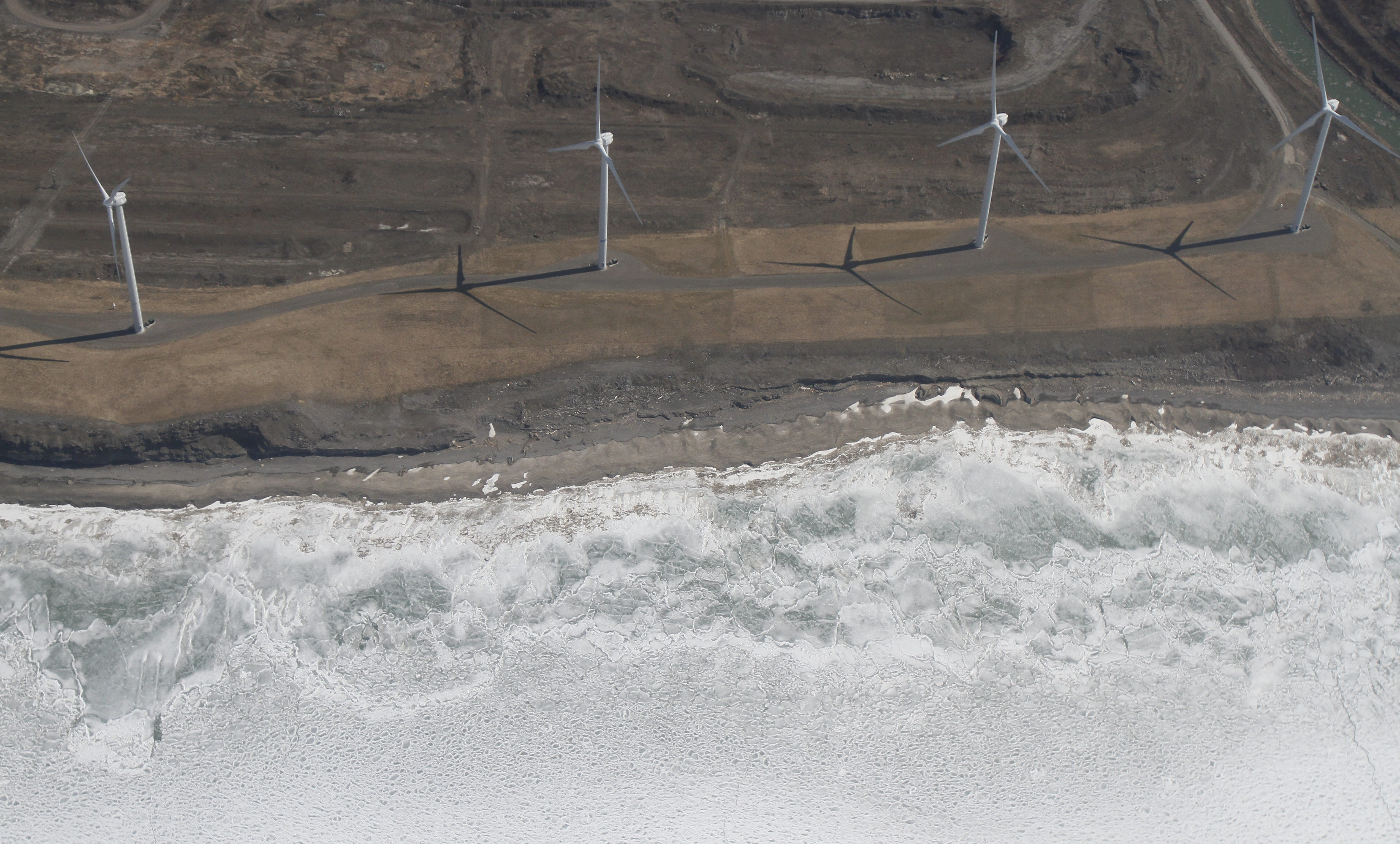Ice rests on the beach near the wind turbines in Lackawanna along the lake shore on April 5, 2013.