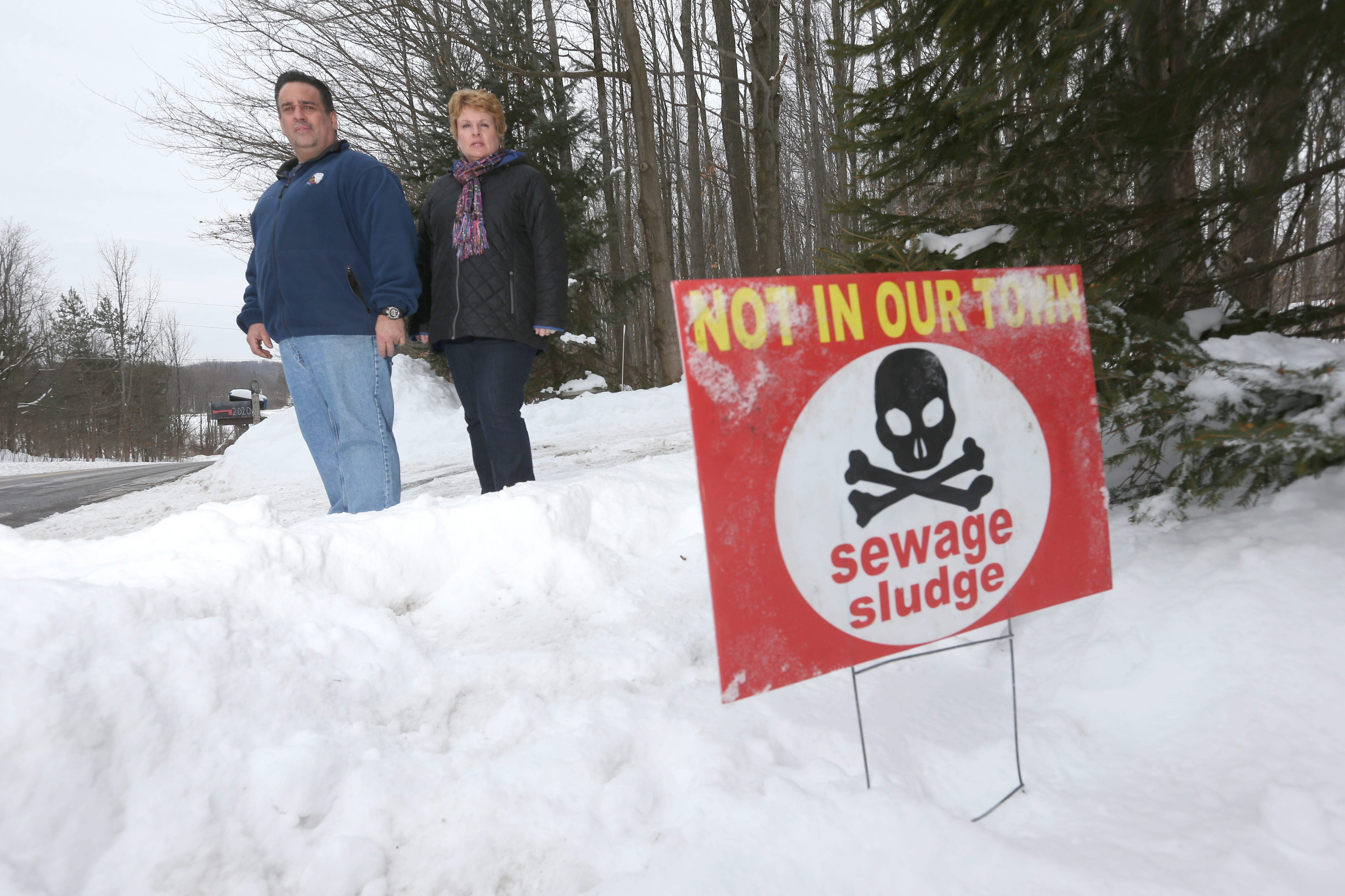 Jeff and Sue Keenan have joined in with the protest of a proposed sewer sludge tank they believe is too close to their Marilla home.