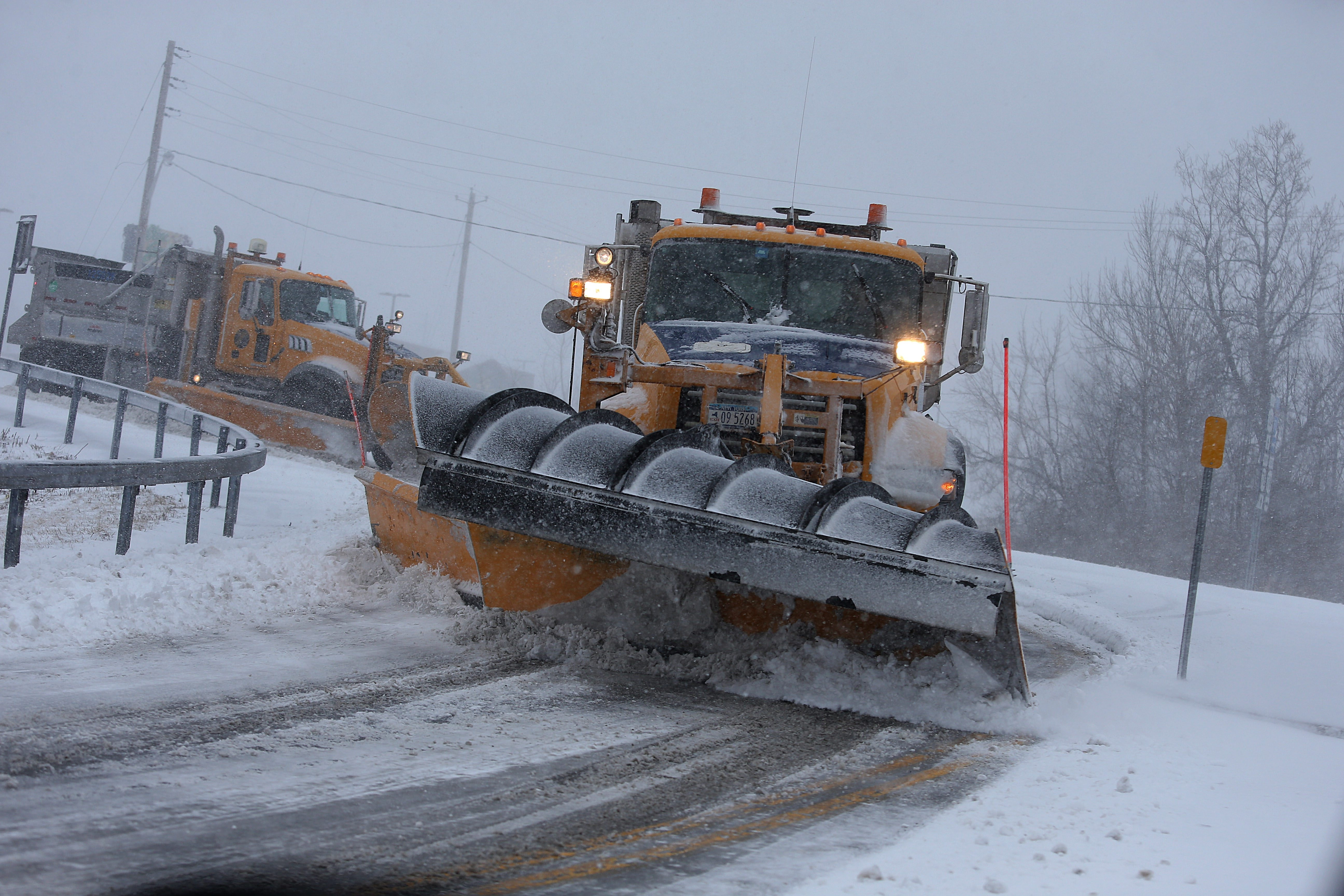 Two snowplows turn toward Transit Road on Sheridan Drive in Amherst on Wednesday, as the second blizzard of the winter battered Western New York. Transportation workers across the region kept on top of the accumulation throughout the day.