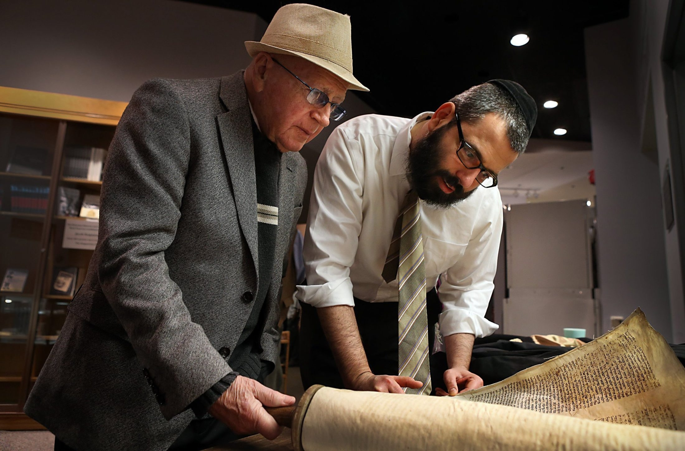 Philip Bialowitz, 84, left, survivor of the Sobibor death camp in Poland during World War II, and Rabbi Hershey Novak look over a late 18th/early 19th century Torah scroll from his homeland of Izbica, Poland during a visit to the Holocaust Museum and Learning Center, Feb. 28, 2014, in St. Louis. (Robert Cohen/St. Louis Post-Dispatch/MCT)