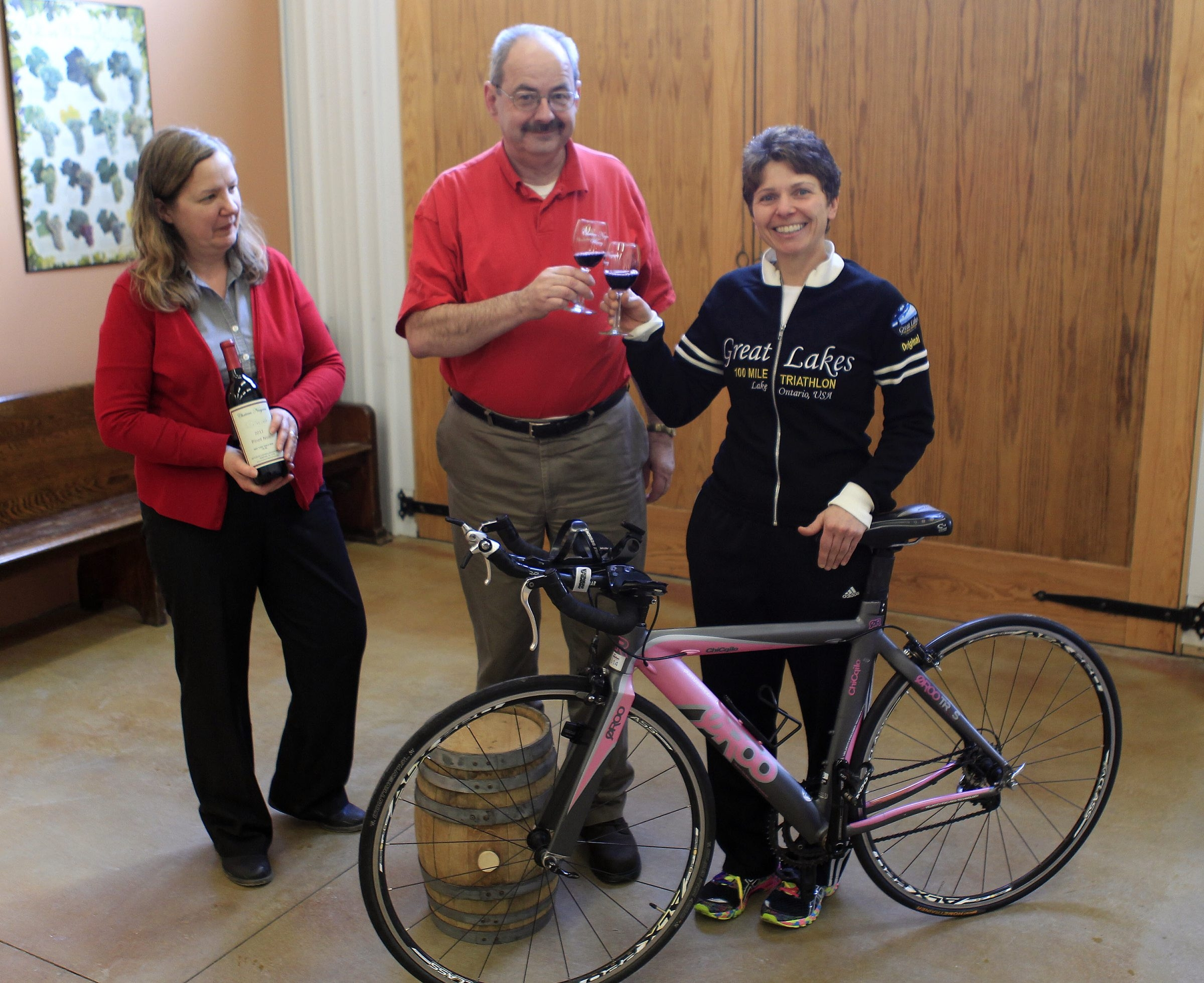 Stefany Critelli, a local biker, is helping organize the new bike ride. She meets with Jim and Kathy Baker.