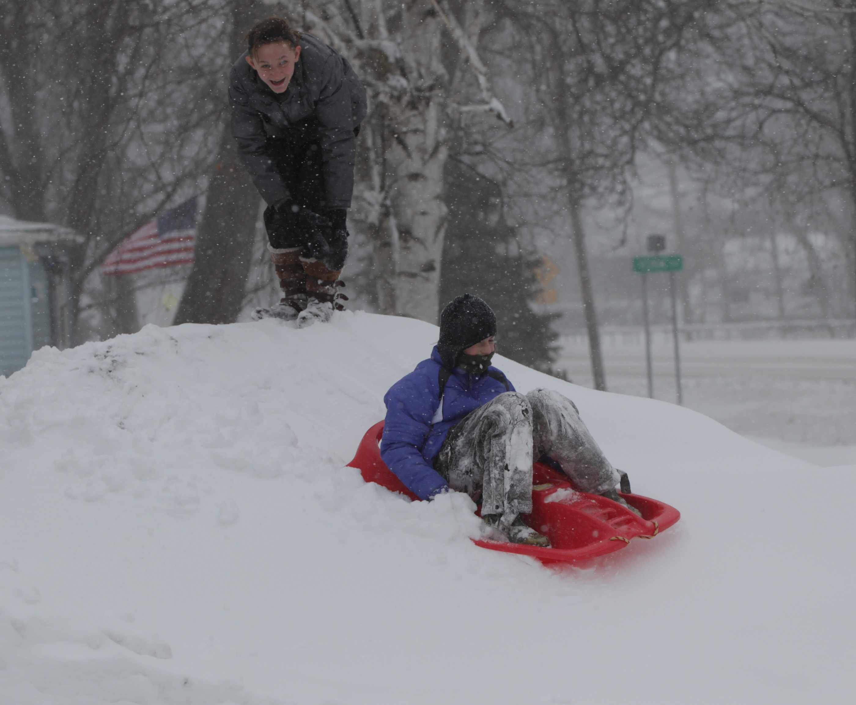 With school closed,  Hallee Mack and Abigail Sawin play in the snow in North Tonawanda Wednesday.