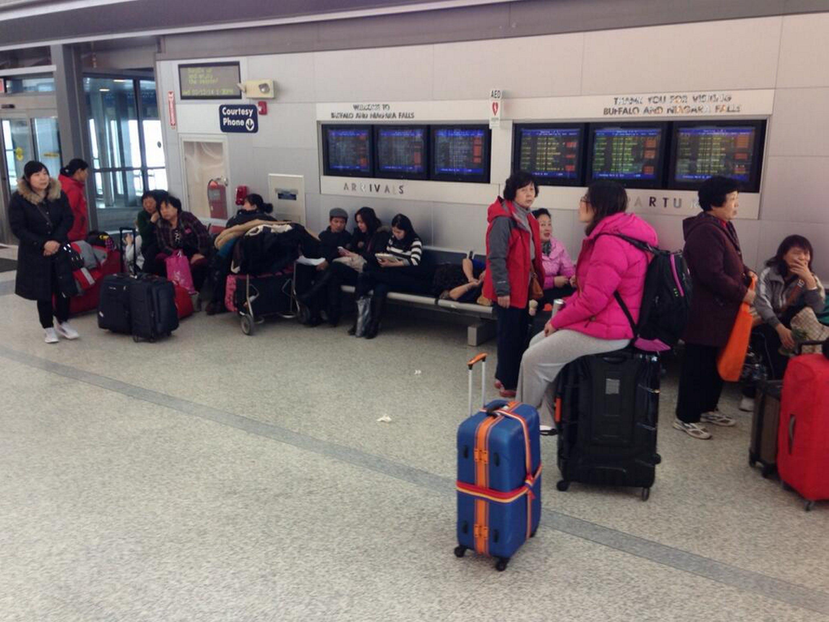Travelers wait due to flight delays and cancellations at Buffalo Niagara International Airport in Cheektowaga. (Charles Lewis/Buffalo News)