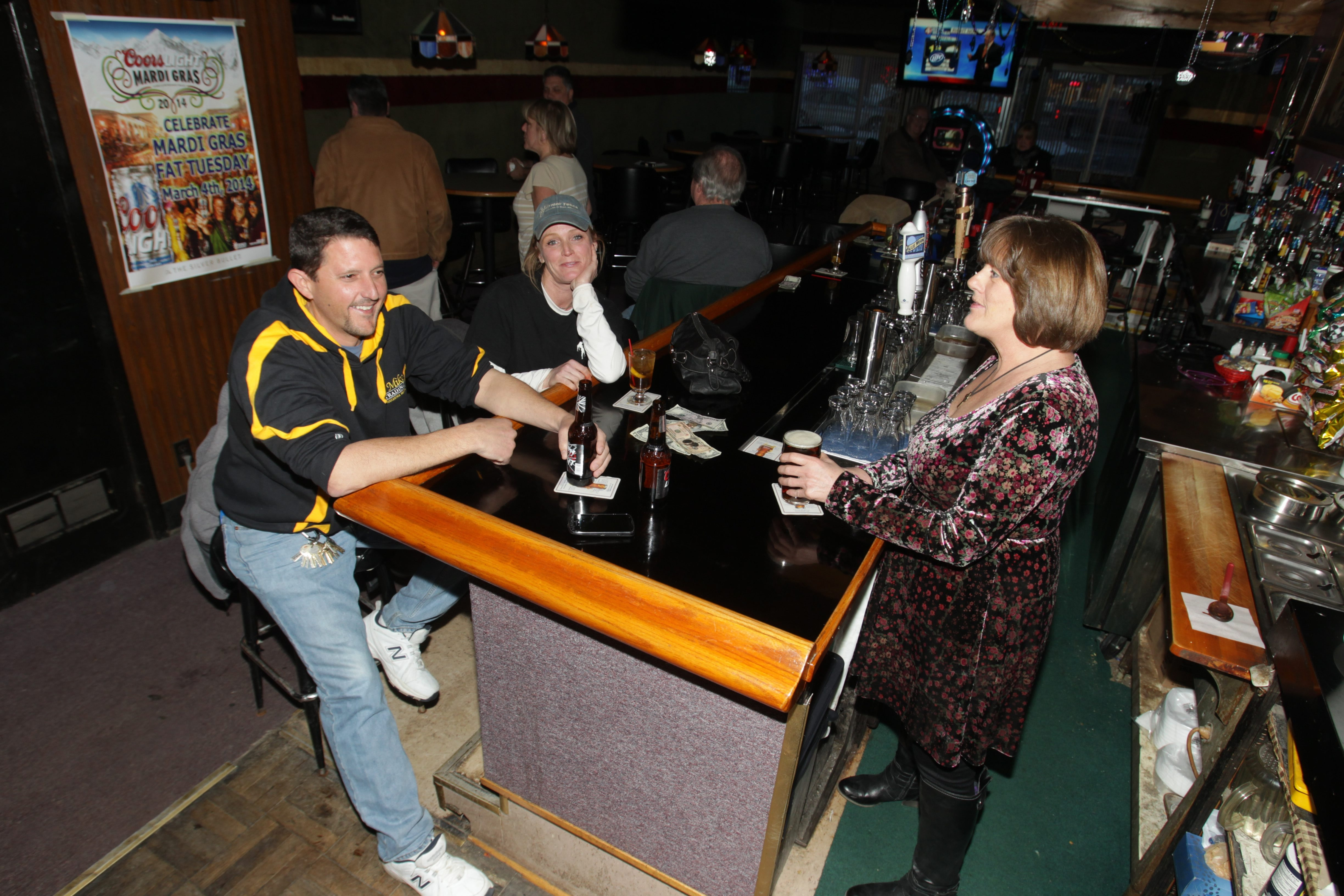 Mary McMahon tends bar at Gray's Place on Delaware Avenue. The Town of Tonawanda bar has been serving patrons for 35 years.