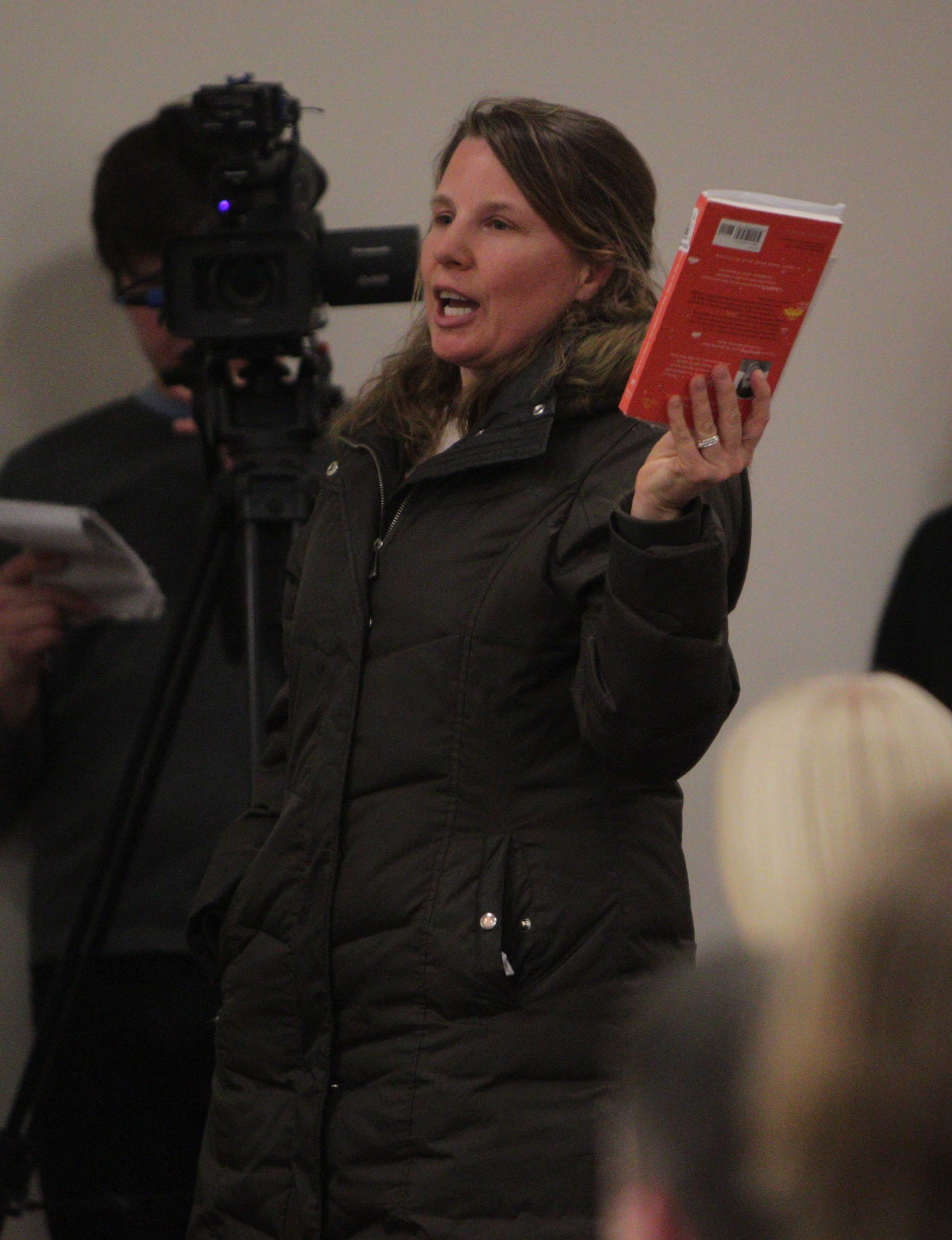 Ginger Lahti, wife of Clarence School Board member Jason Lahti, speaks at Monday's school board meeting, expressing her dissatisfaction with school district policy that a child is sent to the school library when a book parents find objectionable is being discussed in class. (Sharon Cantillon/Buffalo News)