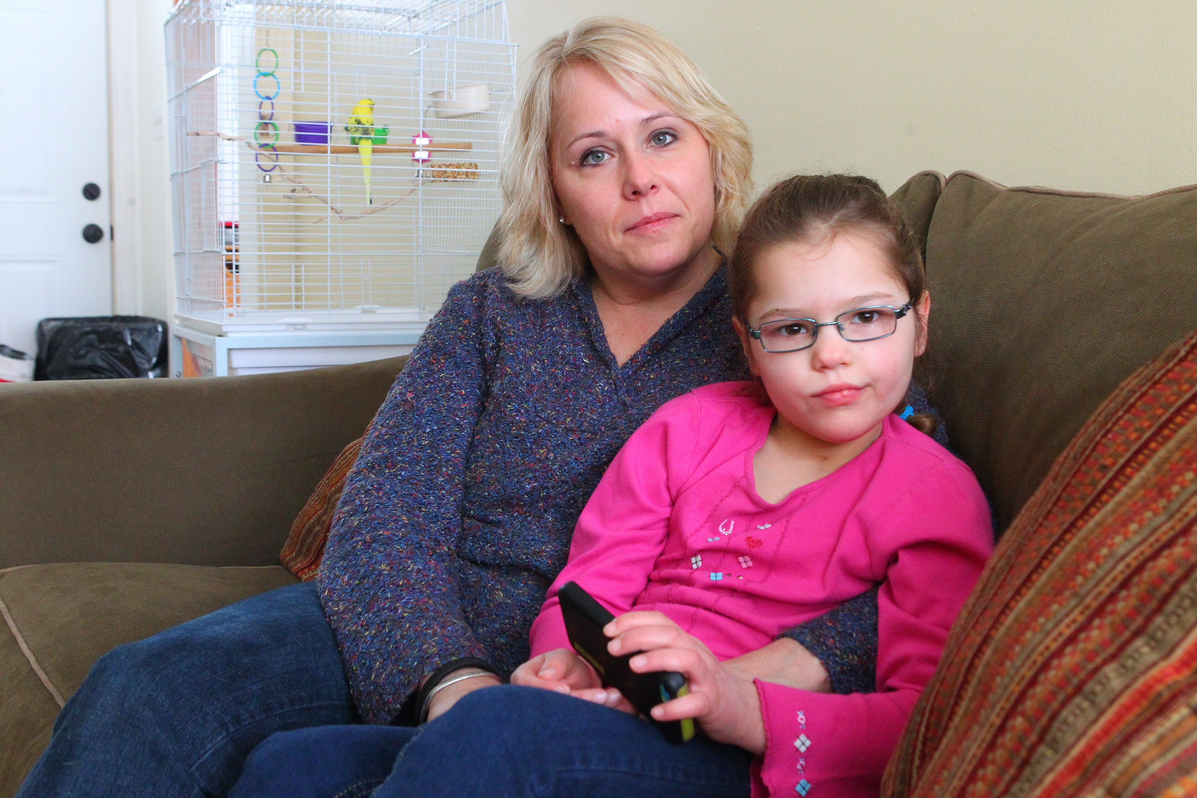 Wendy Conte has changed her legal residence to Colorado that that she can obtain medical marijuana for her daughter, Anna. (John Hickey/Buffalo News)