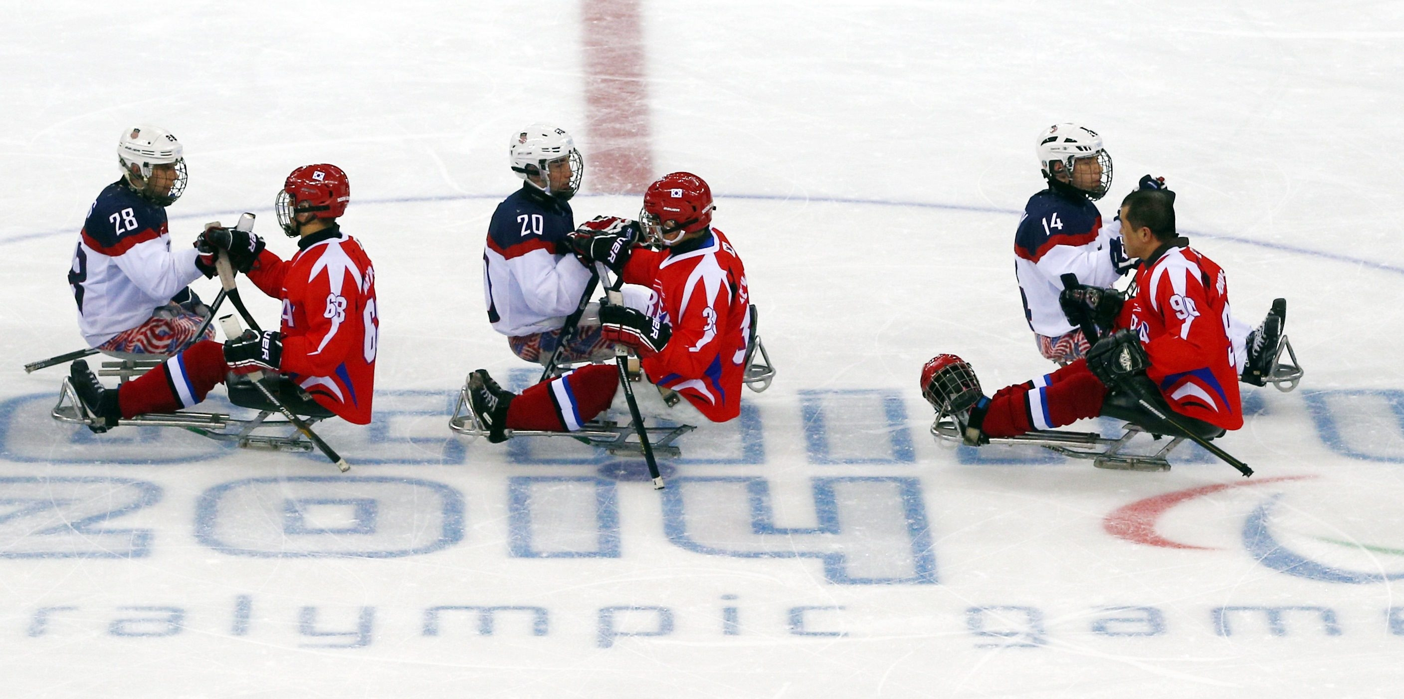 Players from the South Korean and U.S. sled hockey teams shake hands after Sunday's Paralympics match in Sochi, Russia. The United States won, 3-0, and Lancaster's Adam Page – No. 20, at center – scored two of those goals.