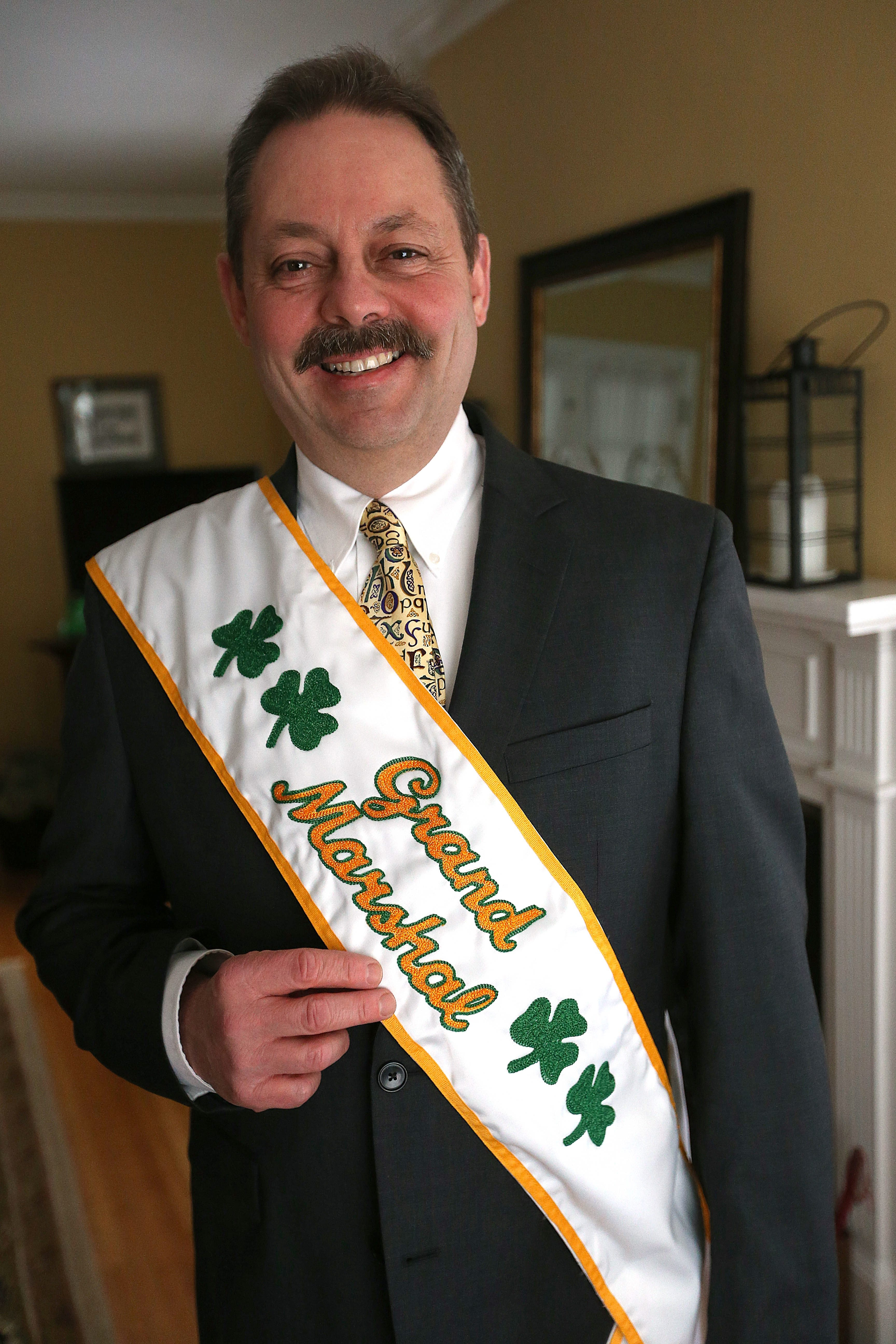 Chris Laffler, who has worked for many years on city parade, is grand marshal for first time.