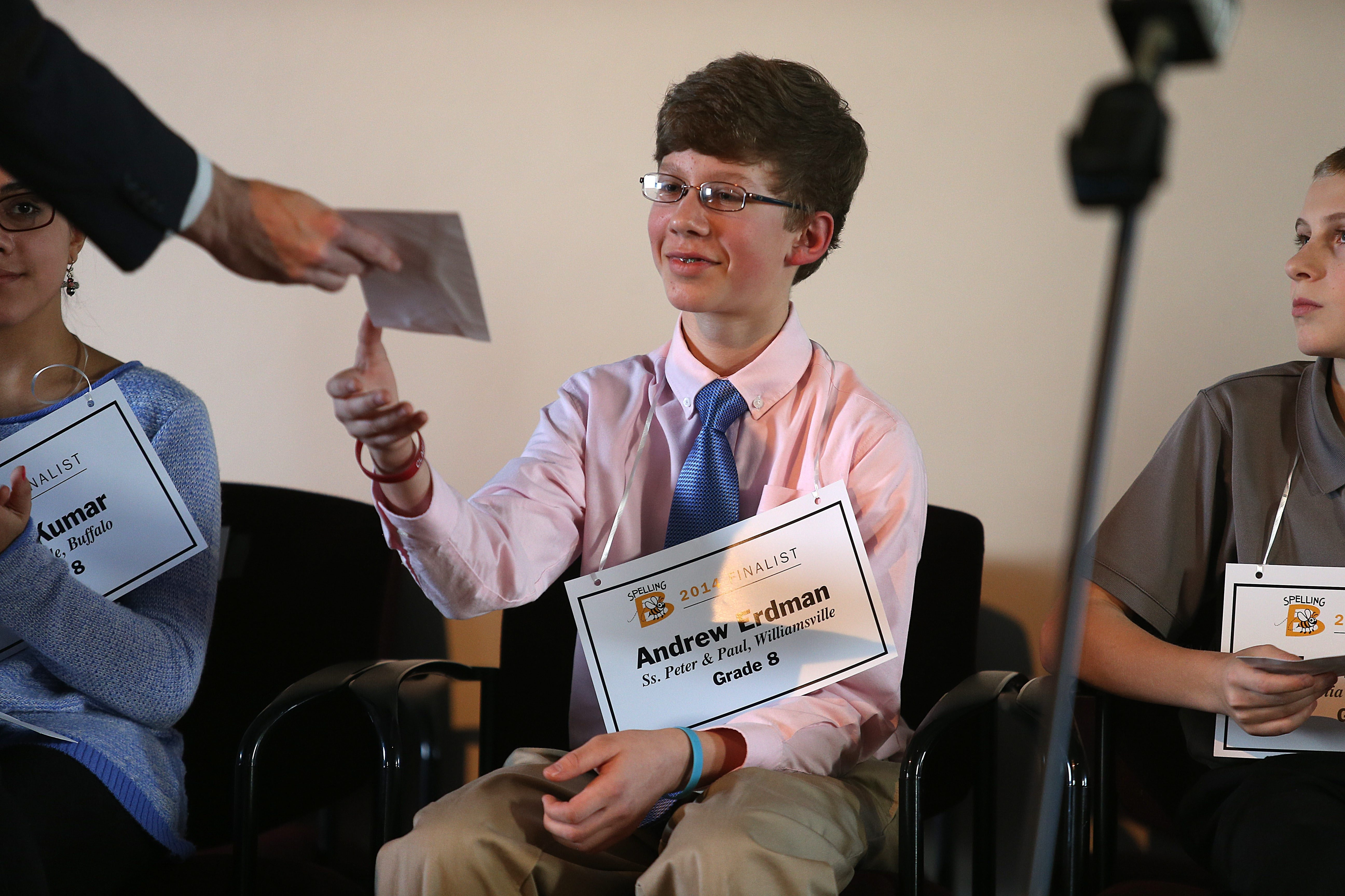 Andrew Erdman, winner of the Buffalo News Spelling Bee, accepts his prize Sunday at the Buffalo History Museum.