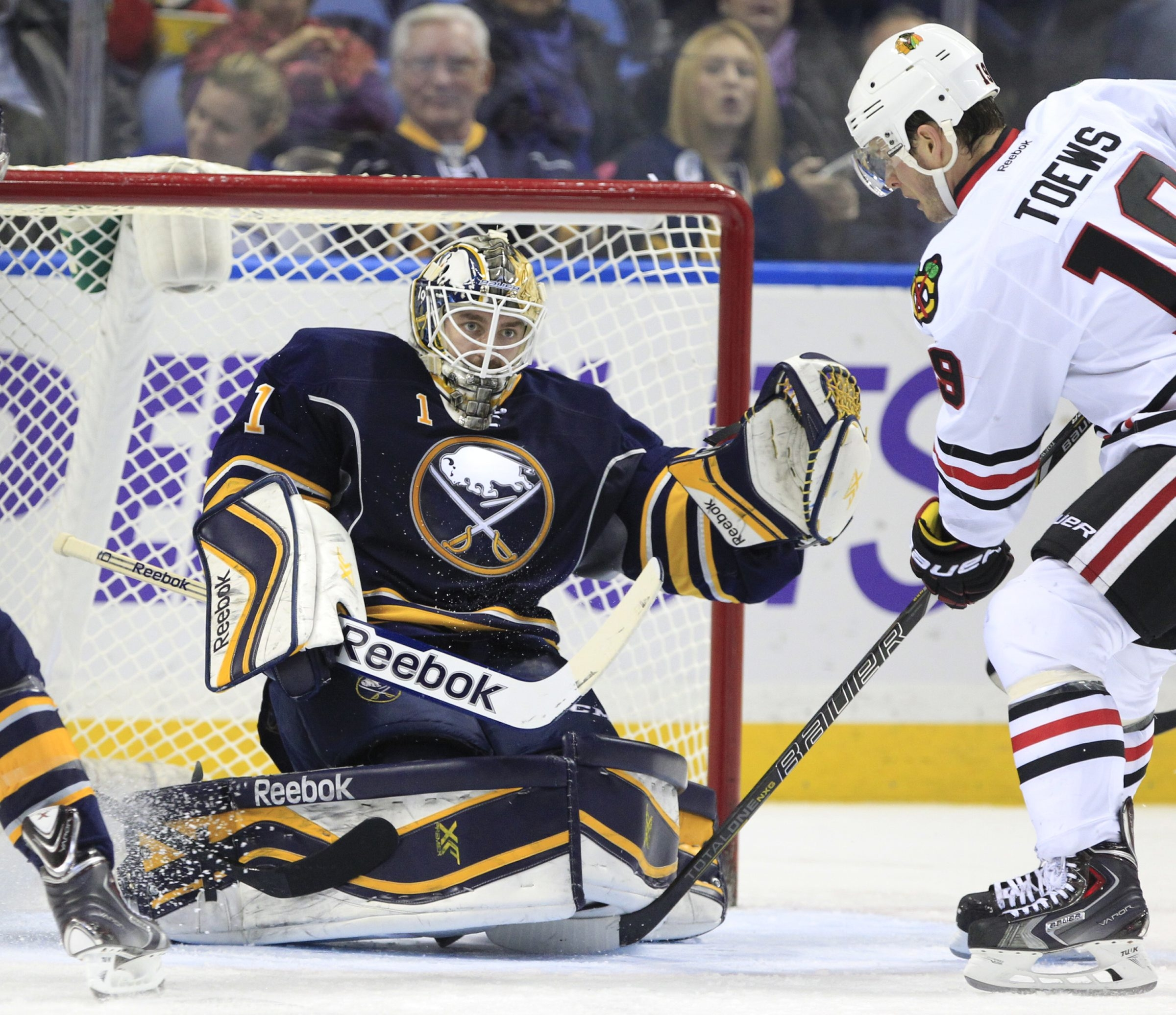 Jhonas Enroth makes one of his 29 saves for the Sabres, but Jonathan Toews got his revenge and scored the game-winner in the third period to lead Chicago to a 2-1 win at First Niagara Center.(Harry Scull Jr./Buffalo News)