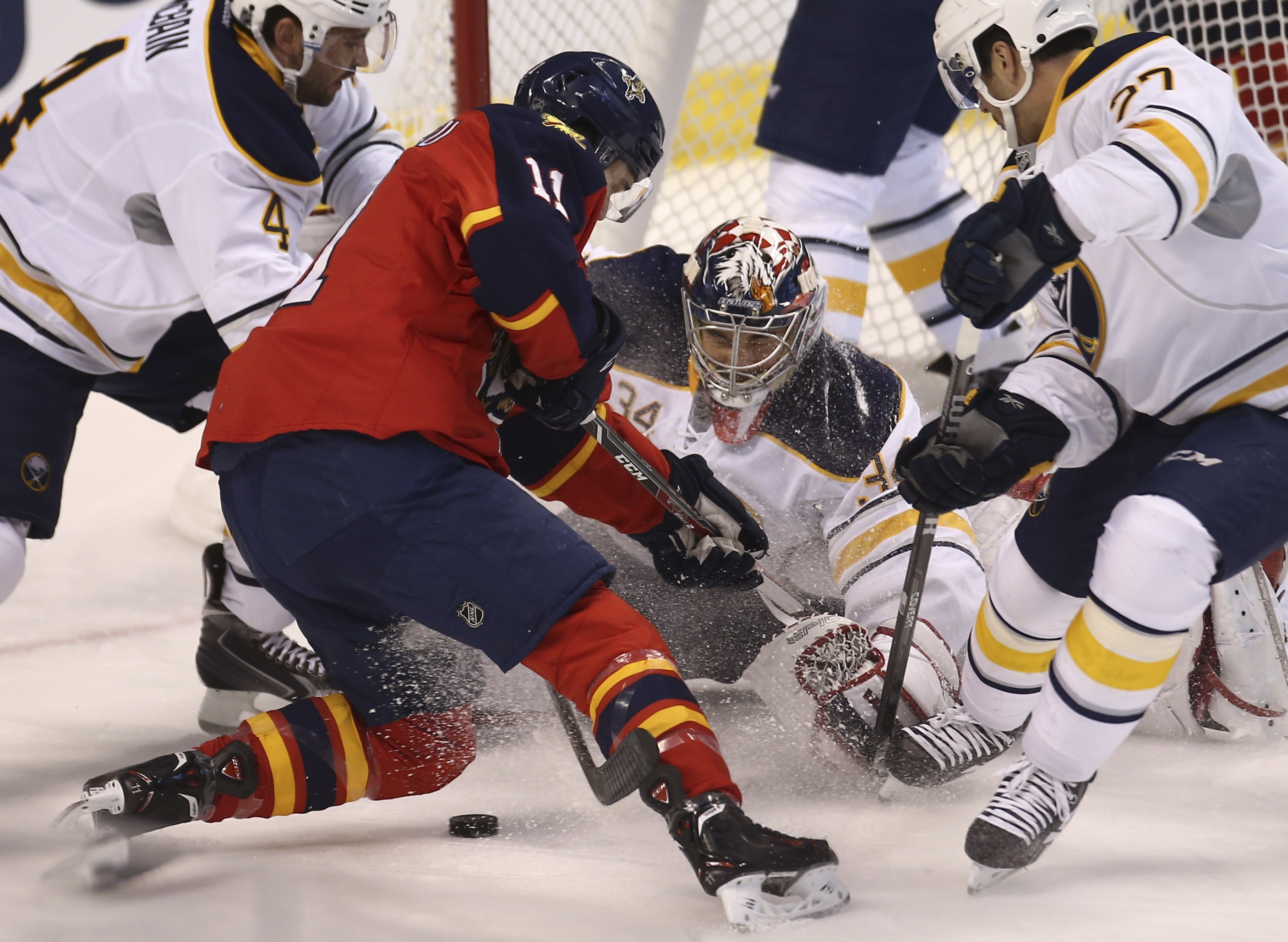 Goalie Michal Neuvirth makes his Sabres debut, stopping a shot by the Panthers' Jonathan Huberdeau. Florida won, 2-0.