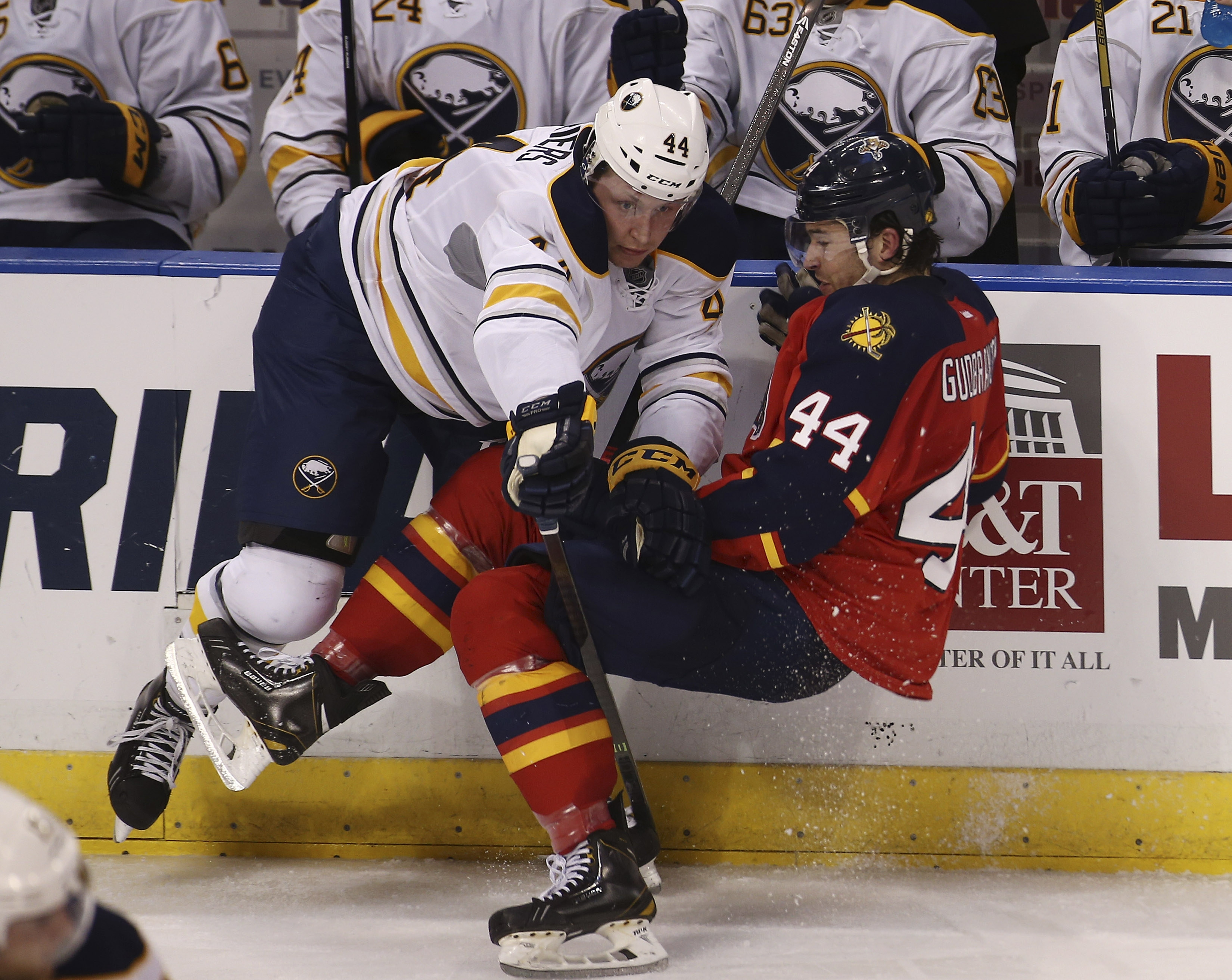 Buffalo Sabres' Nicolas Deslauriers (44) bowls over the Florida Panthers' Erik Gudbranson (44) during the third period in Deslauriers' NHL debut.