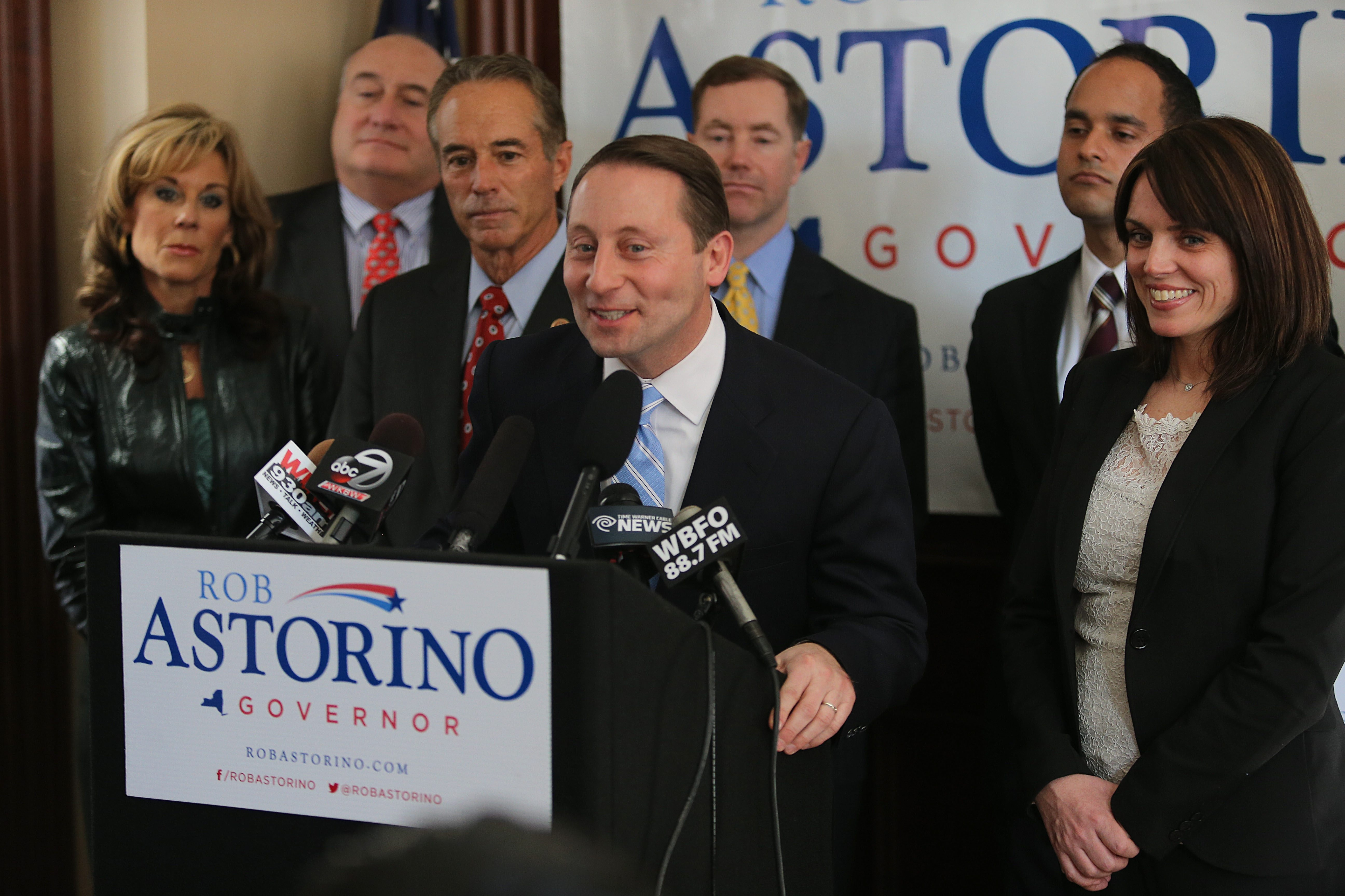 Westchester County Executive Rob Astorino speaks about his decision to run for New York State governor Thursday at the Zeptomerix Corp. building in Buffalo, as his wife, Sheila McCluskey, right, looks on. Zeptometrix owner Rep. Chris Collins, R-Clarence, is at Astorino's right.